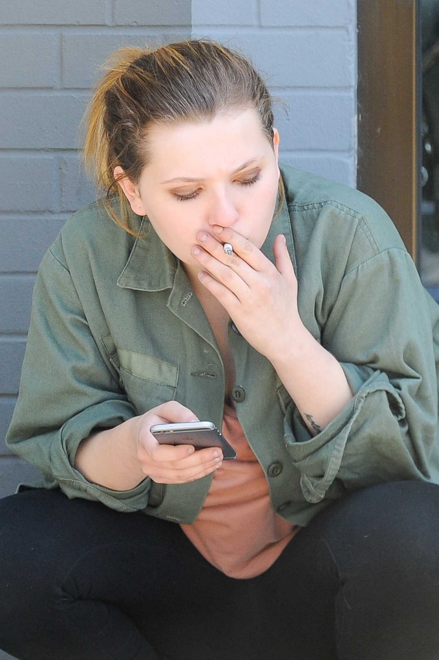 Abigail Breslin Enjoys a Cigarette in West Hollywood 06/25/2016