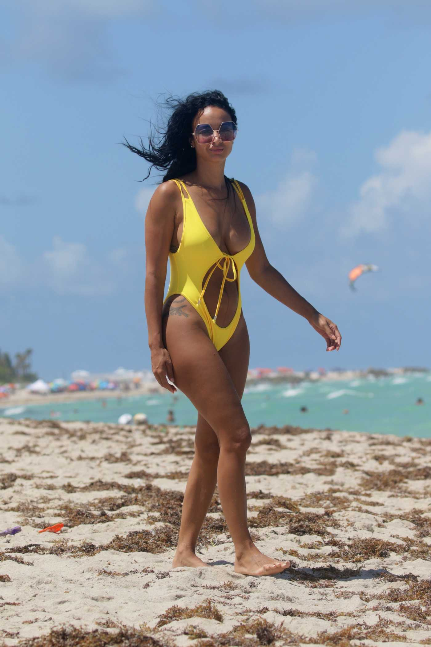 Draya Michele in a Yellow Swimsuit at the Beach in Miami 07/17/2016