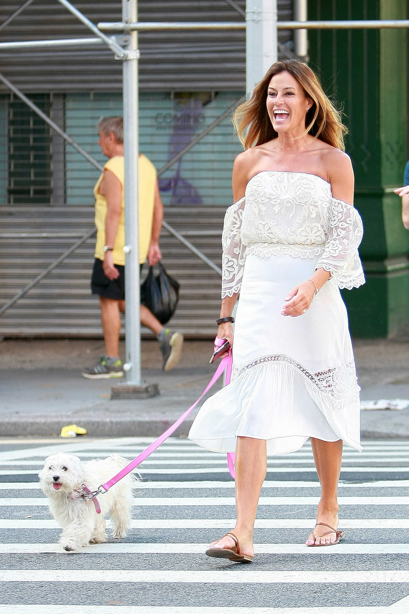 Kelly Bensimon With Her Dog Steps Out in Soho, New York 08/22/2016