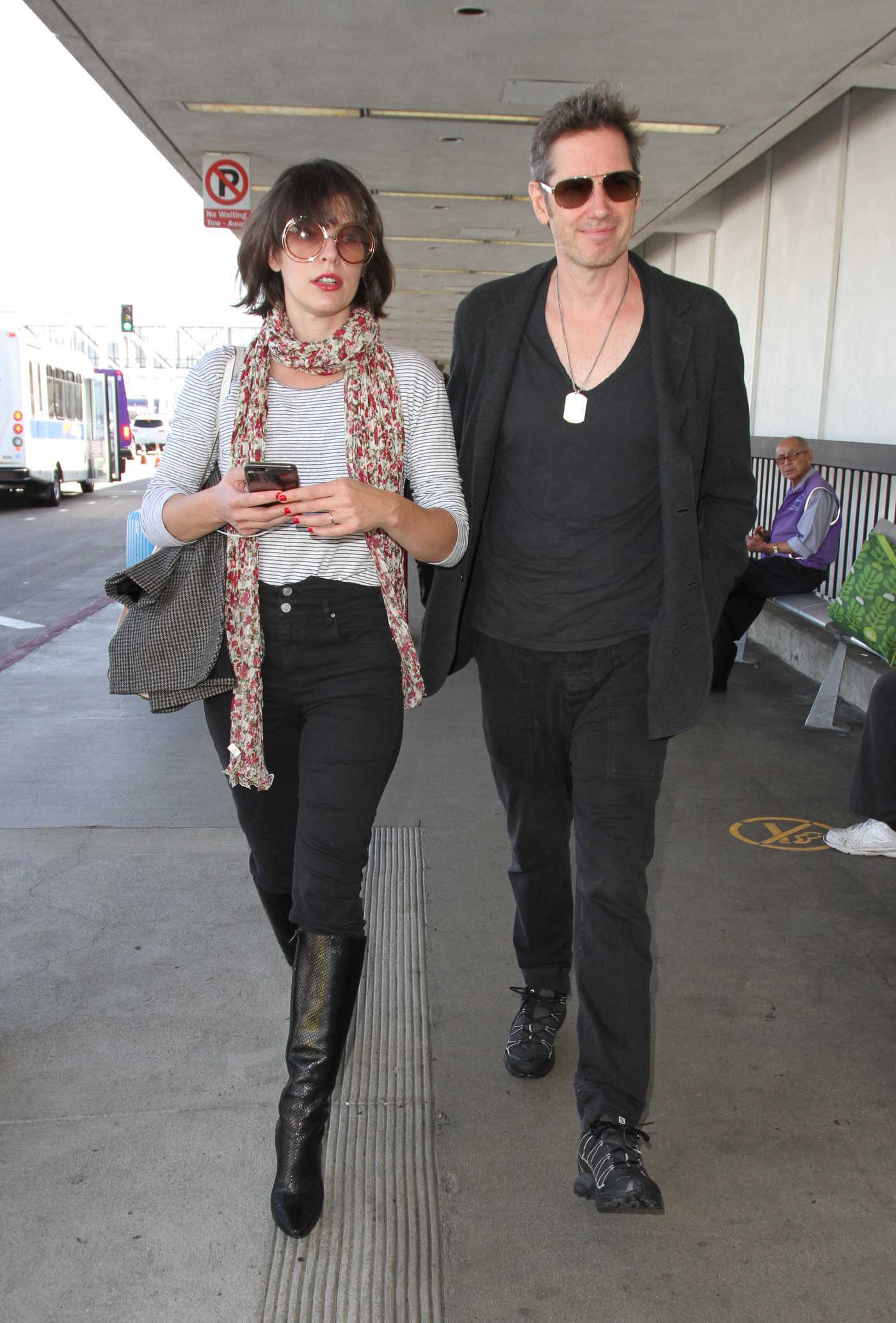 Milla Jovovich Departs From LAX Airport in Los Angeles 10/06/2016