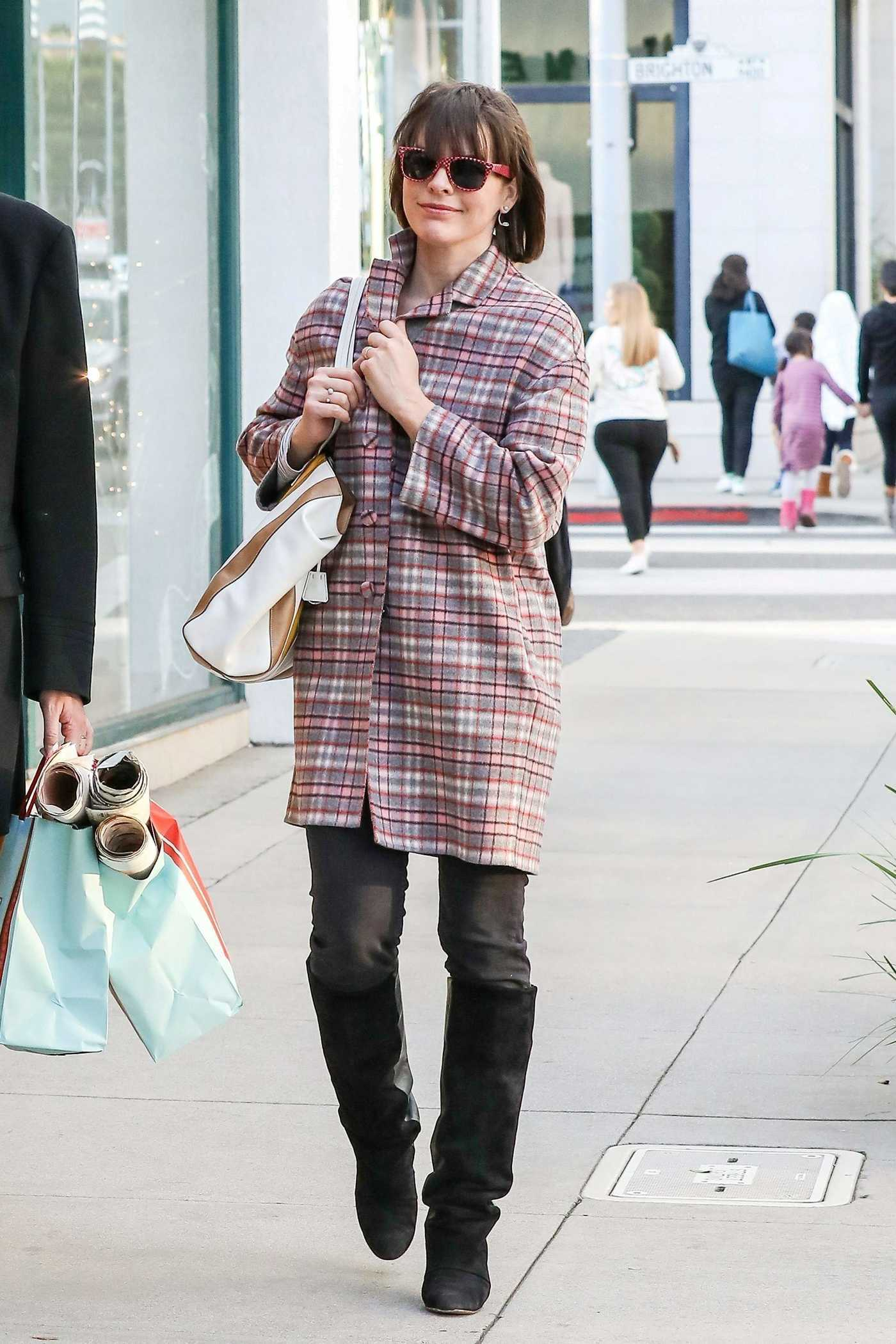 Milla Jovovich Goes Shopping in Beverly Hills 12/22/2016