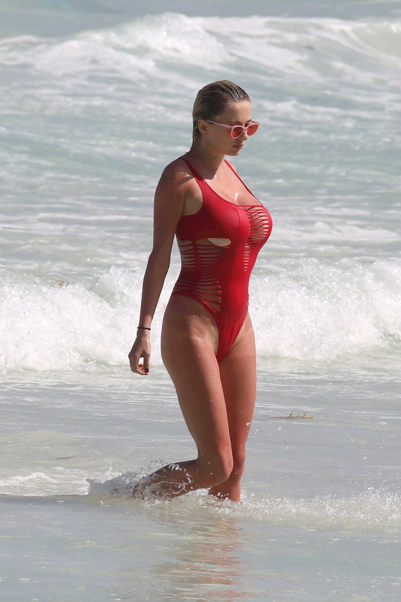 Caroline Vreeland Wears a Red Swimsuit at Tulum Beach in Mexico 03/26/2017