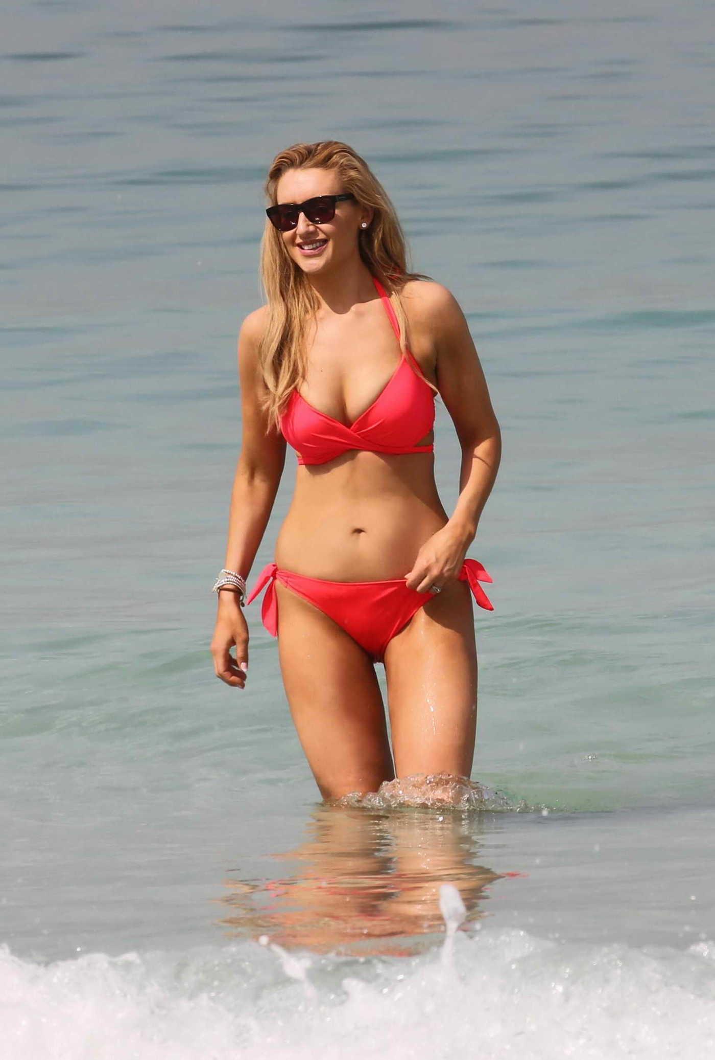 Catherine Tyldesley Wears a Red Bikini at the Beach in Dubai 03/28/2017