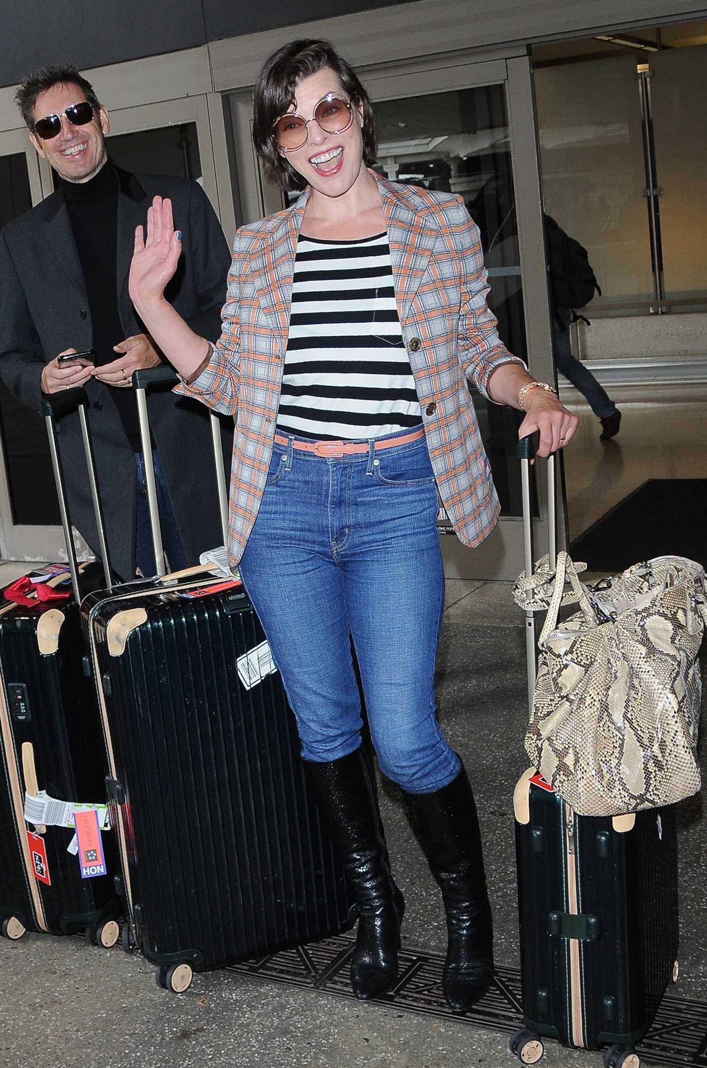 Milla Jovovich Was Seen at LAX Airport in Los Angeles 05/10/2017