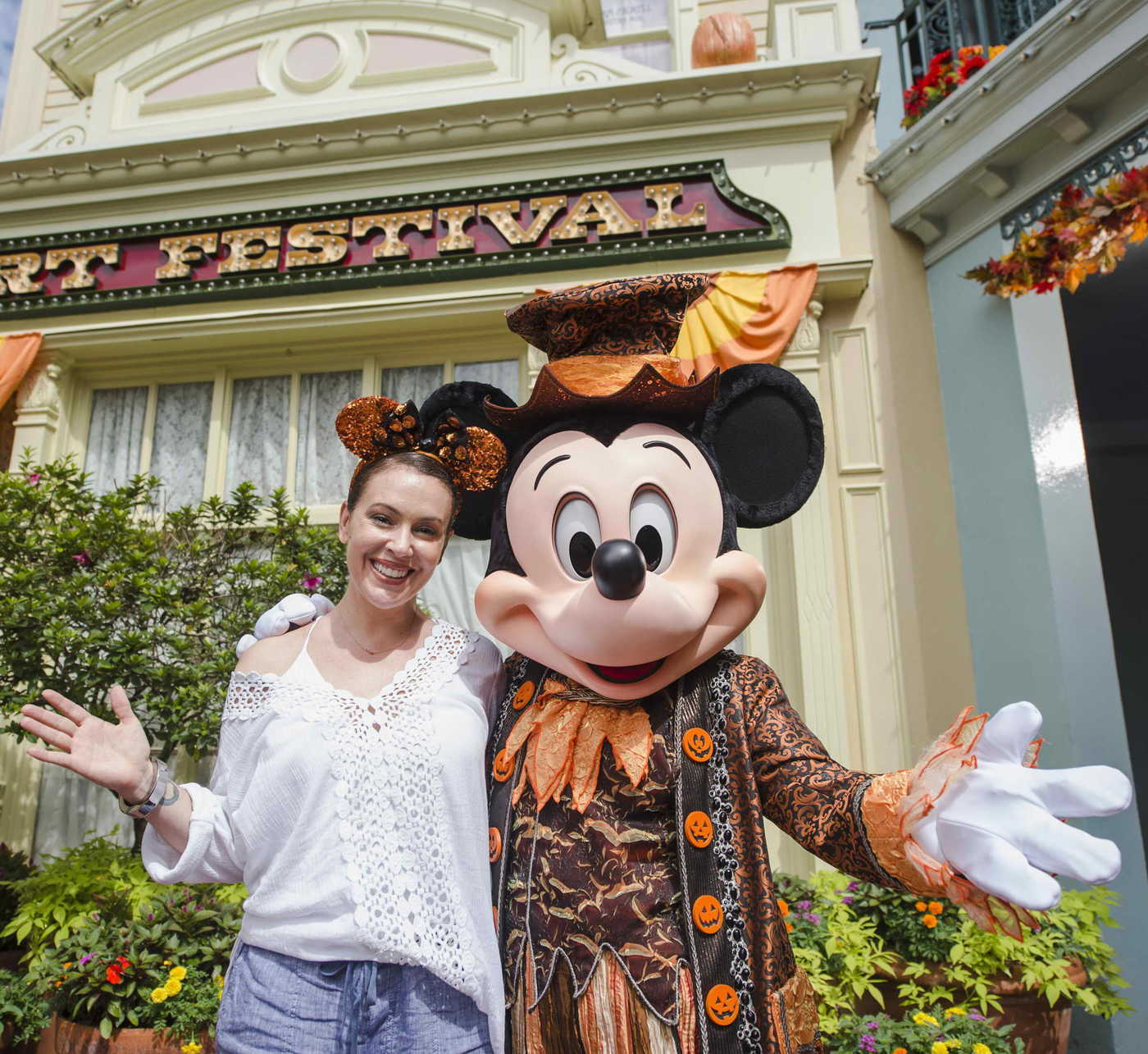 Alyssa Milano Posing With Mickey Mouse at Magic Kingdom Park in Lake Buena Vista 08/29/2017