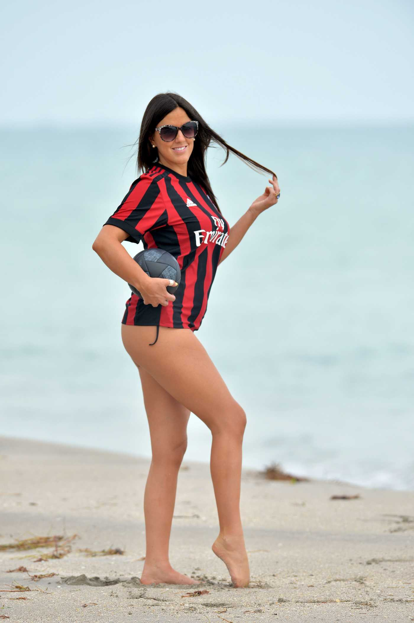 Claudia Romani Wears A.C. Milan Team Jersey at the Beach in Miami 09/27/2017