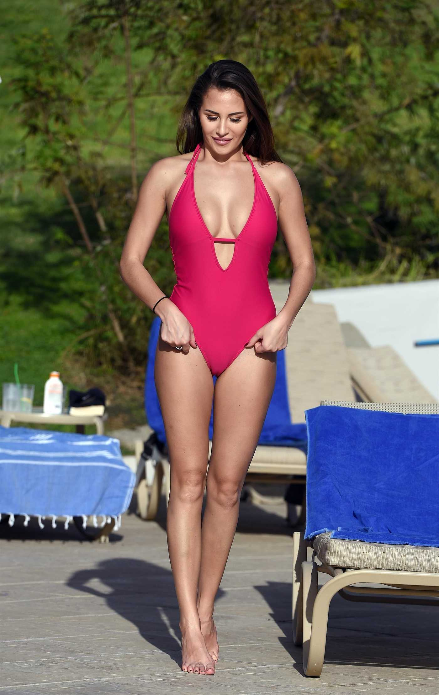 Chloe Goodman Wears a Red Swimsuit by the Pool in Malta 12/28/2017