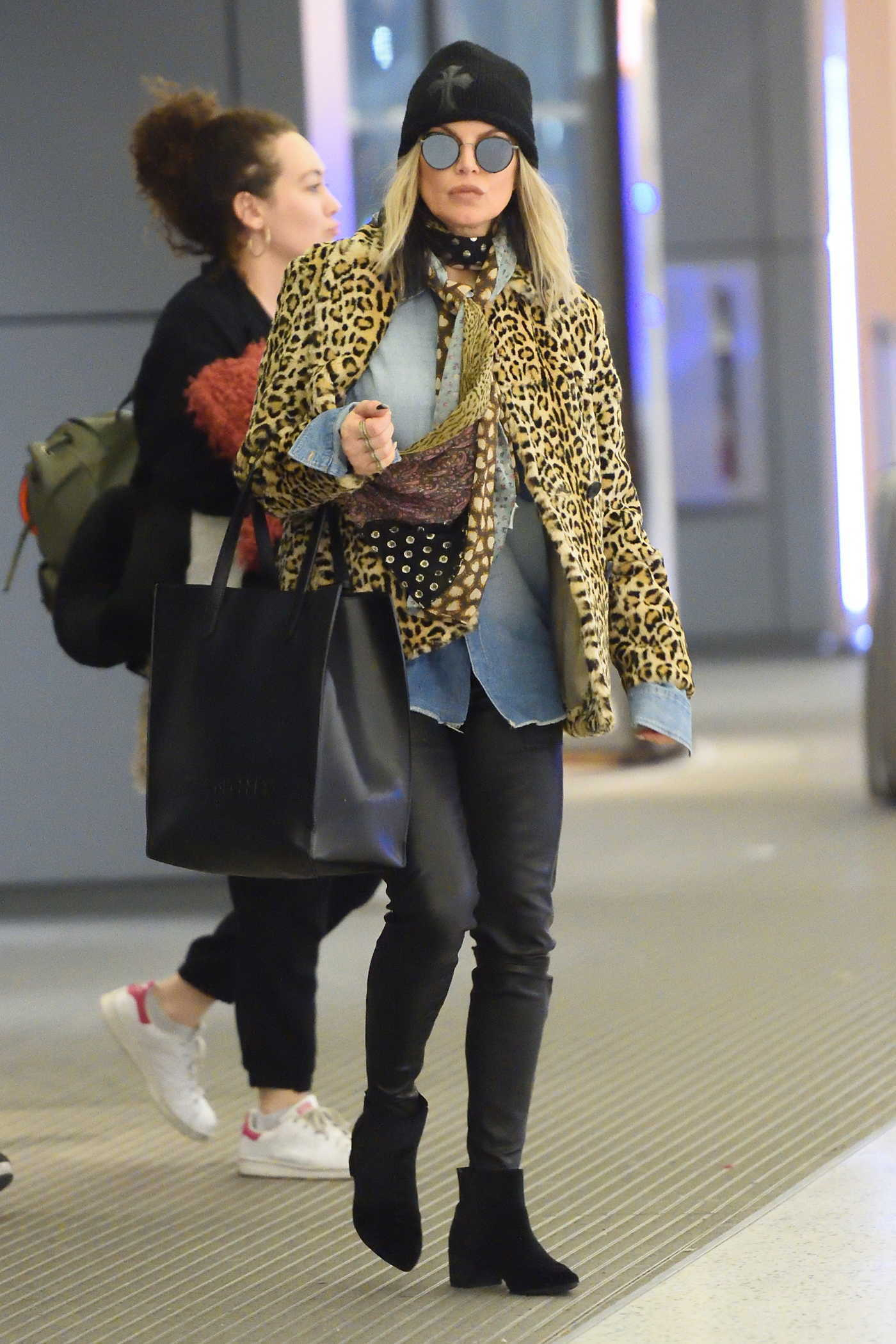 Fergie Wears a Leopard Print Jacket at JFK airport in NYC 12/17/2017