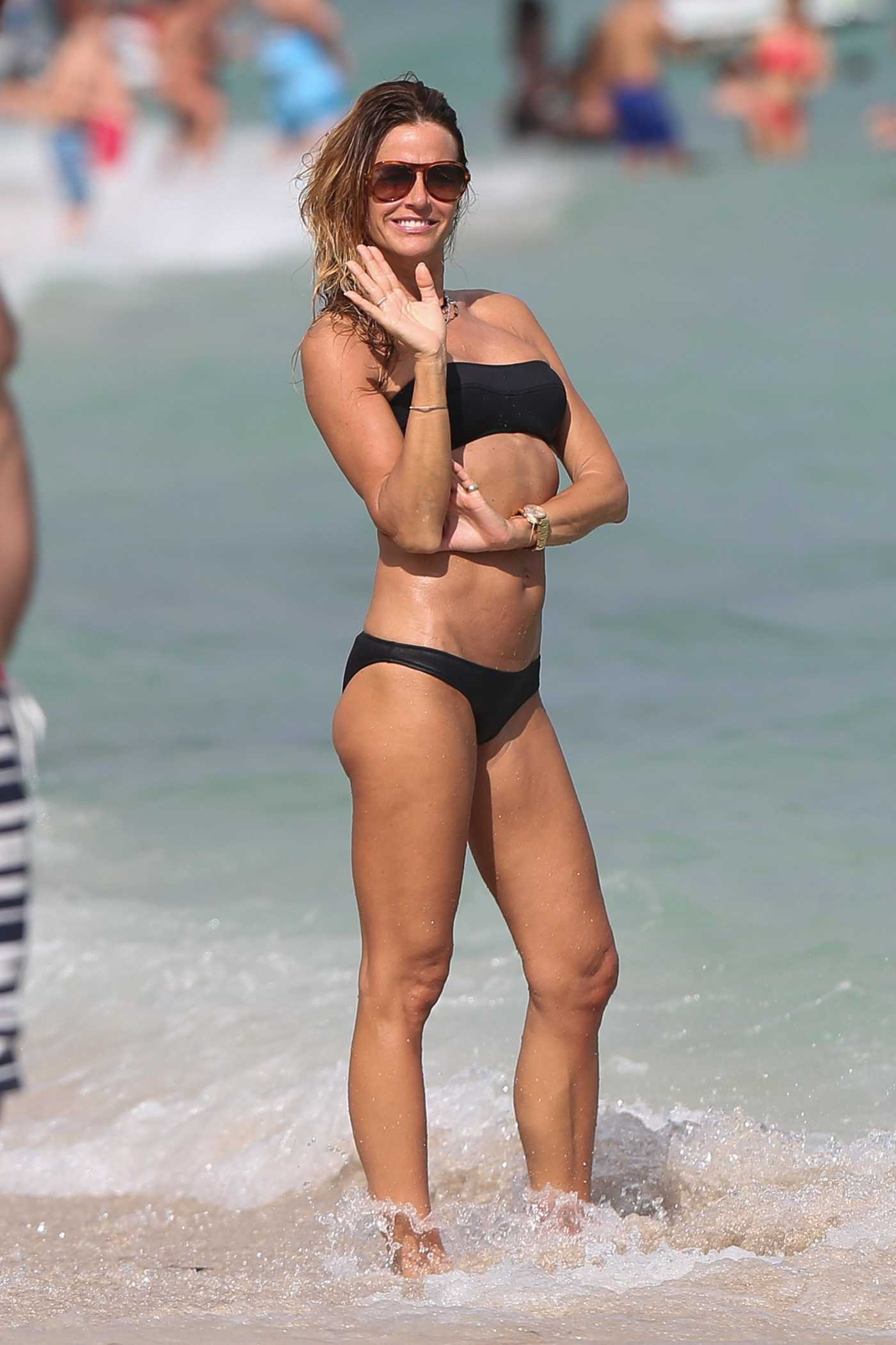 Kelly Bensimon Wears a Black Bikini at the Beach in Miami 12/27/2017