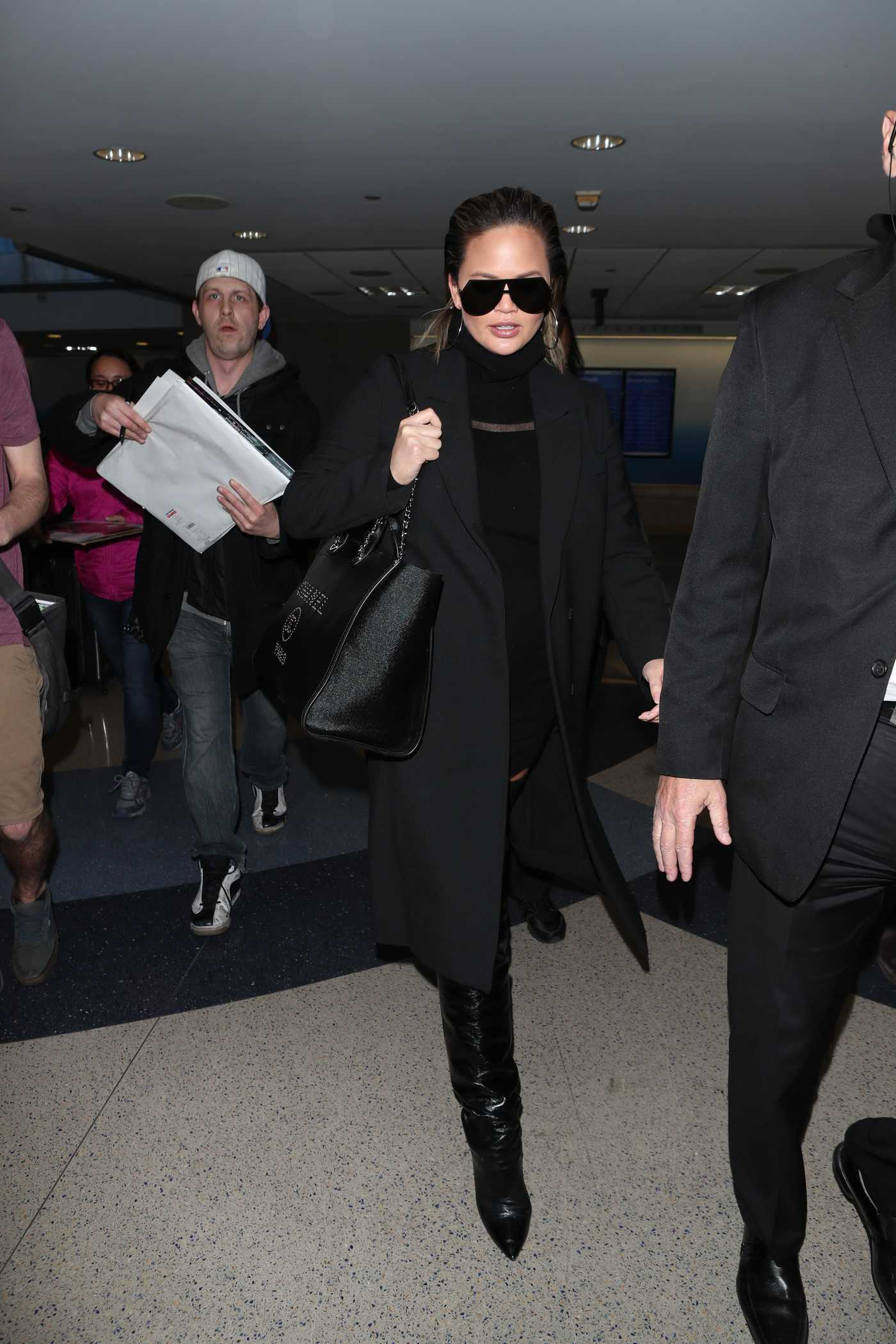 Chrissy Teigen Arrives at LAX Airport in LA 02/22/2018