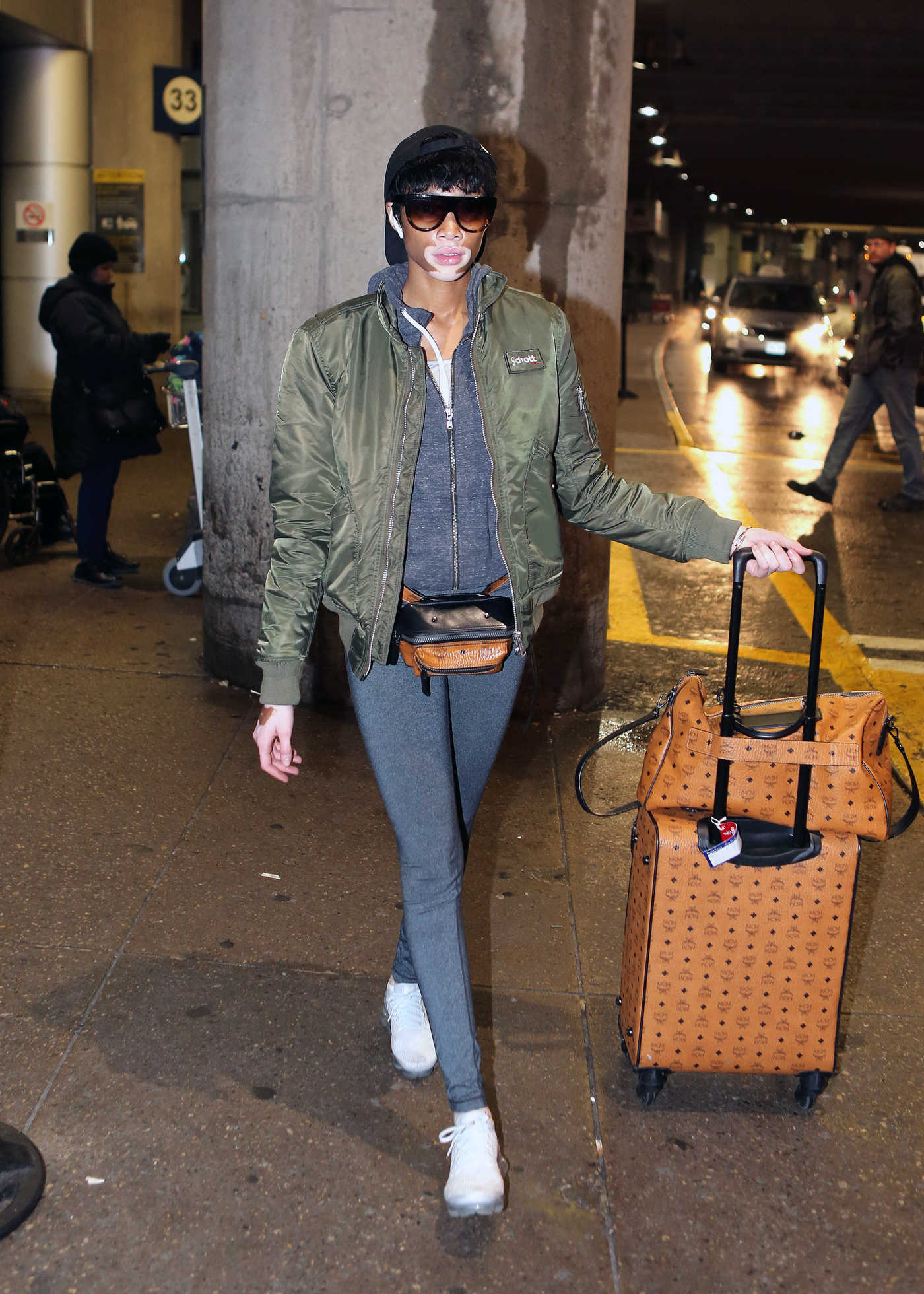 Winnie Harlow Wears a Schott NYC Green Bomber Jacket at Pearson International Airport in Toronto 03/28/2018