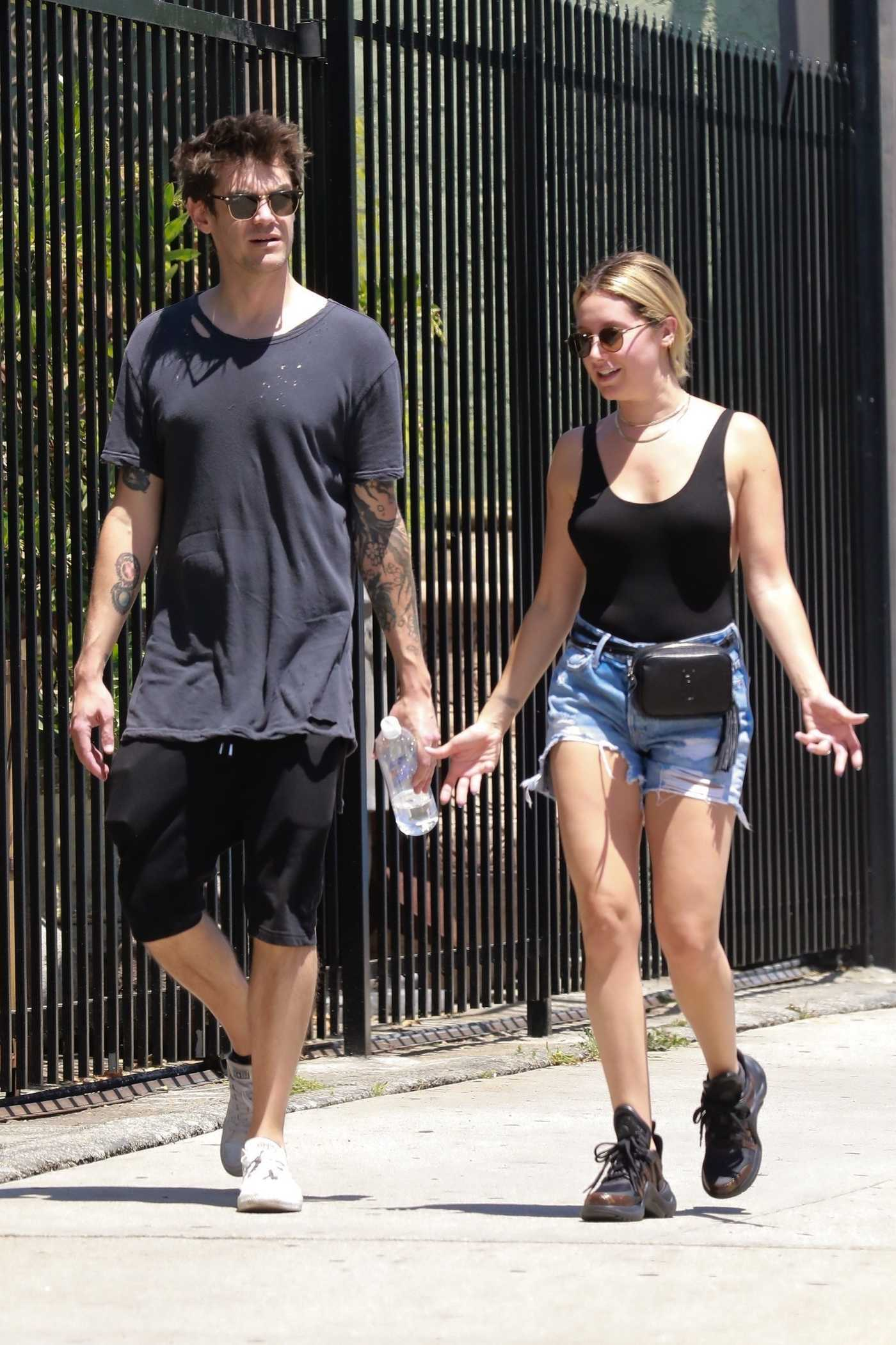 Ashley Tisdale in a Black Tank Top and Denim Shorts Shops with Husband Christopher French in Los Angeles 07/14/2018