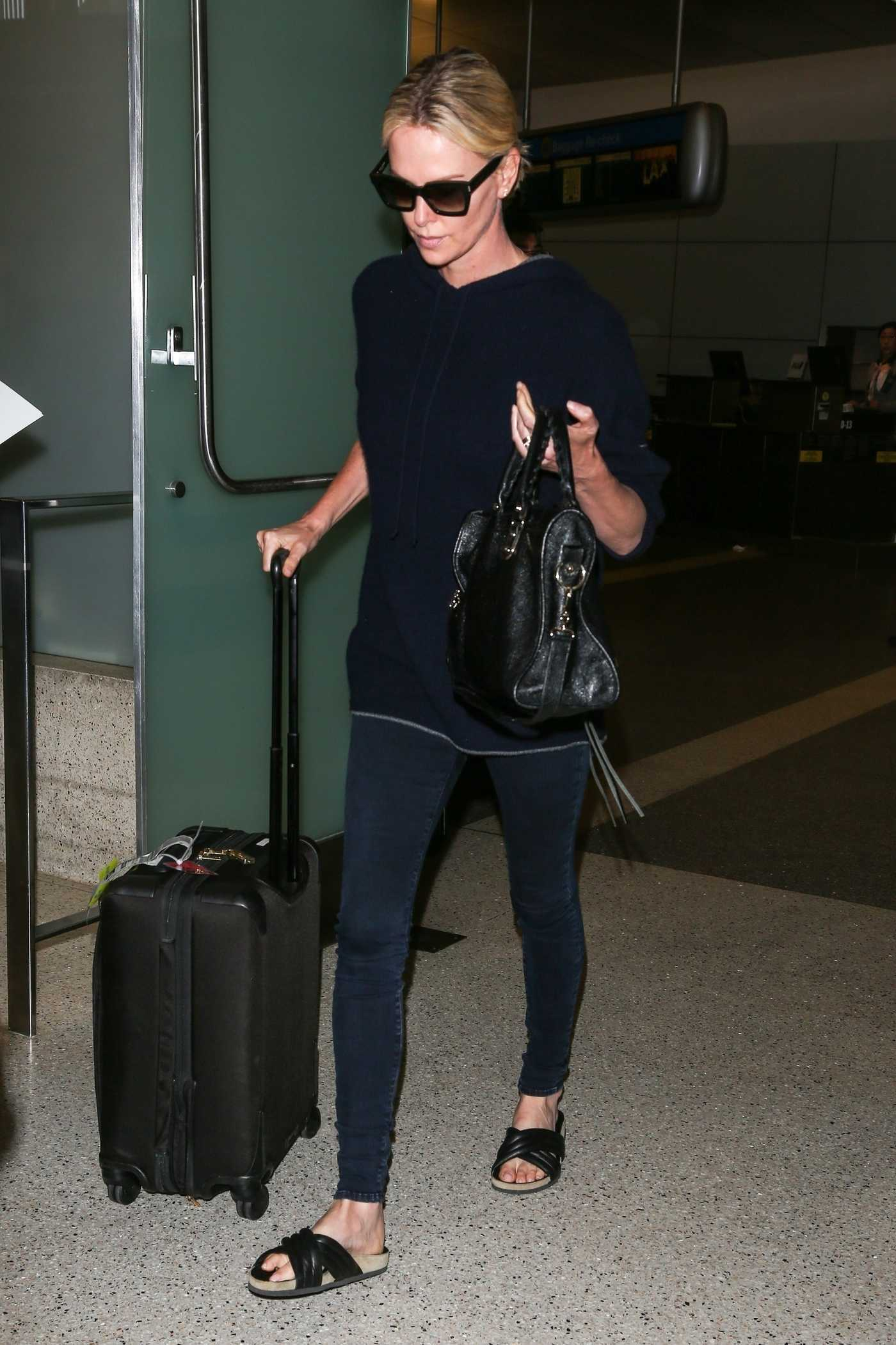 Charlize Theron Lands at LAX Airport in LA 07/25/2018