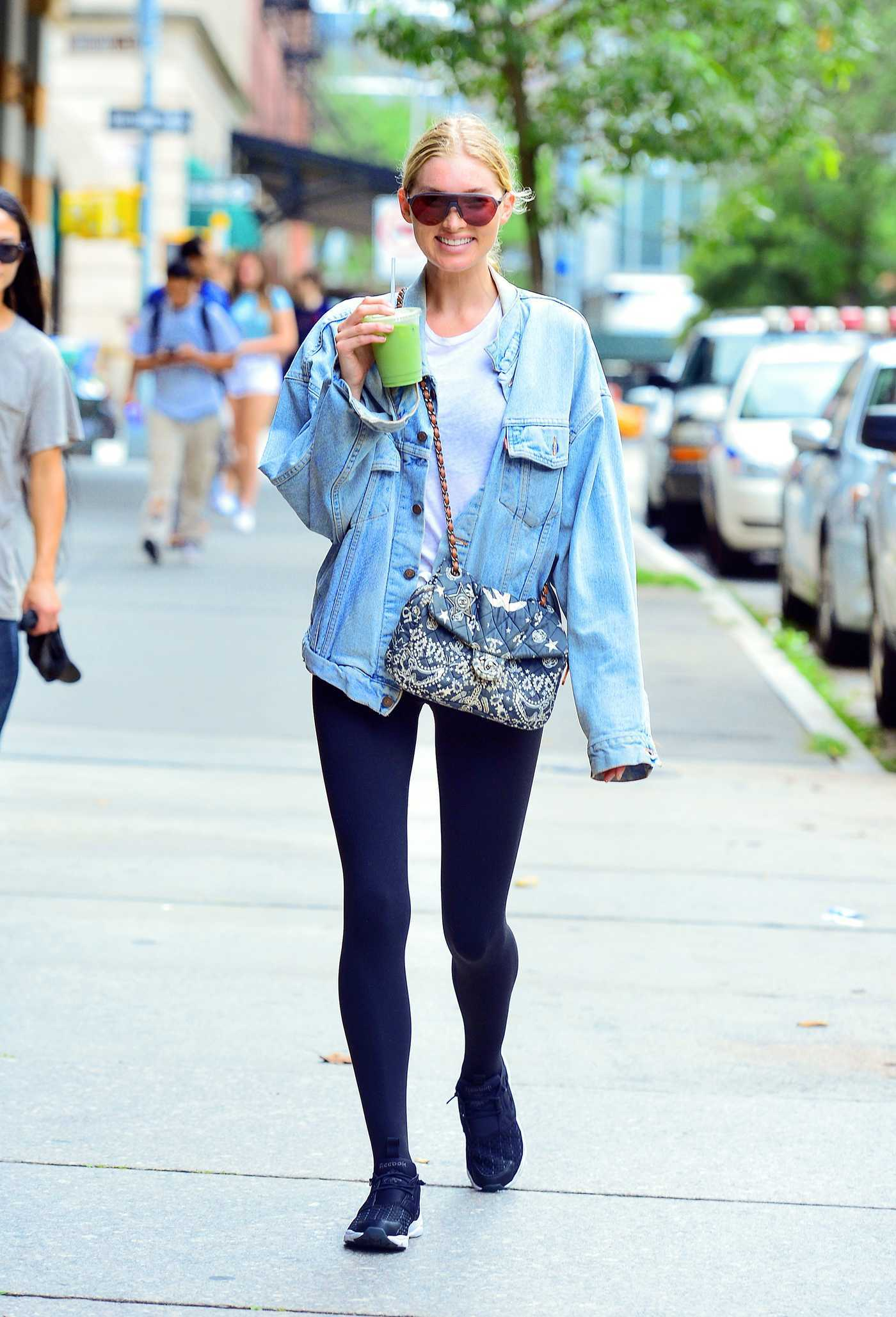 Elsa Hosk in a Blue Denim Jacket Drinks Her Coffee in New York City 07/25/2018
