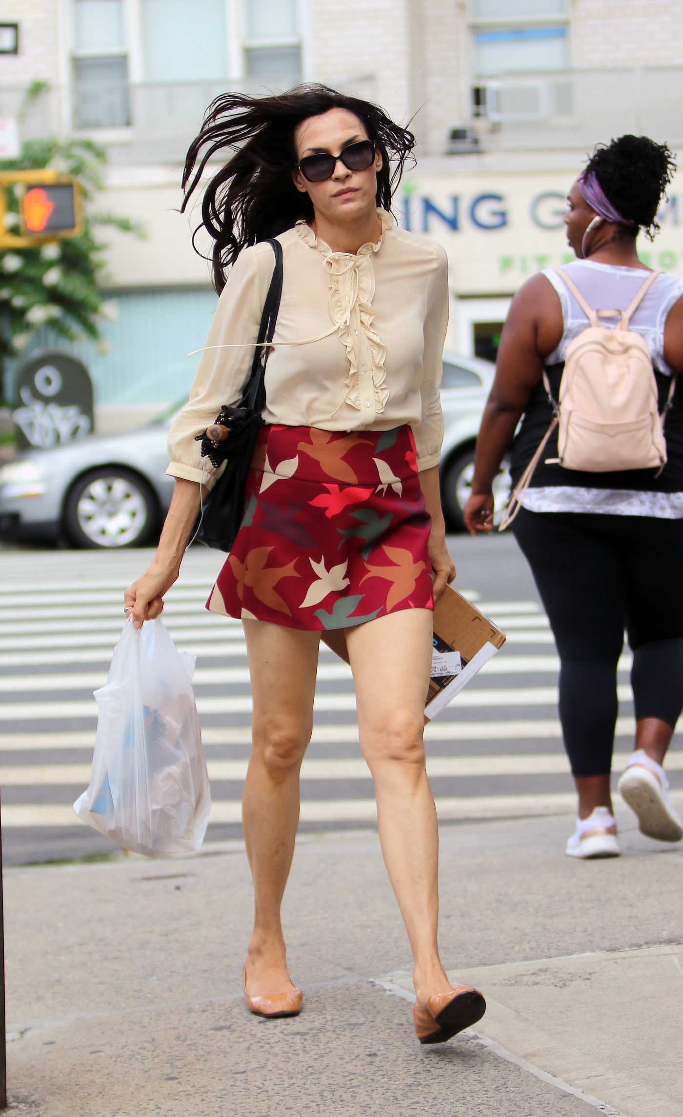 Famke Janssen in a Short Bird Print Skirt Out in New York City 07/24/2018