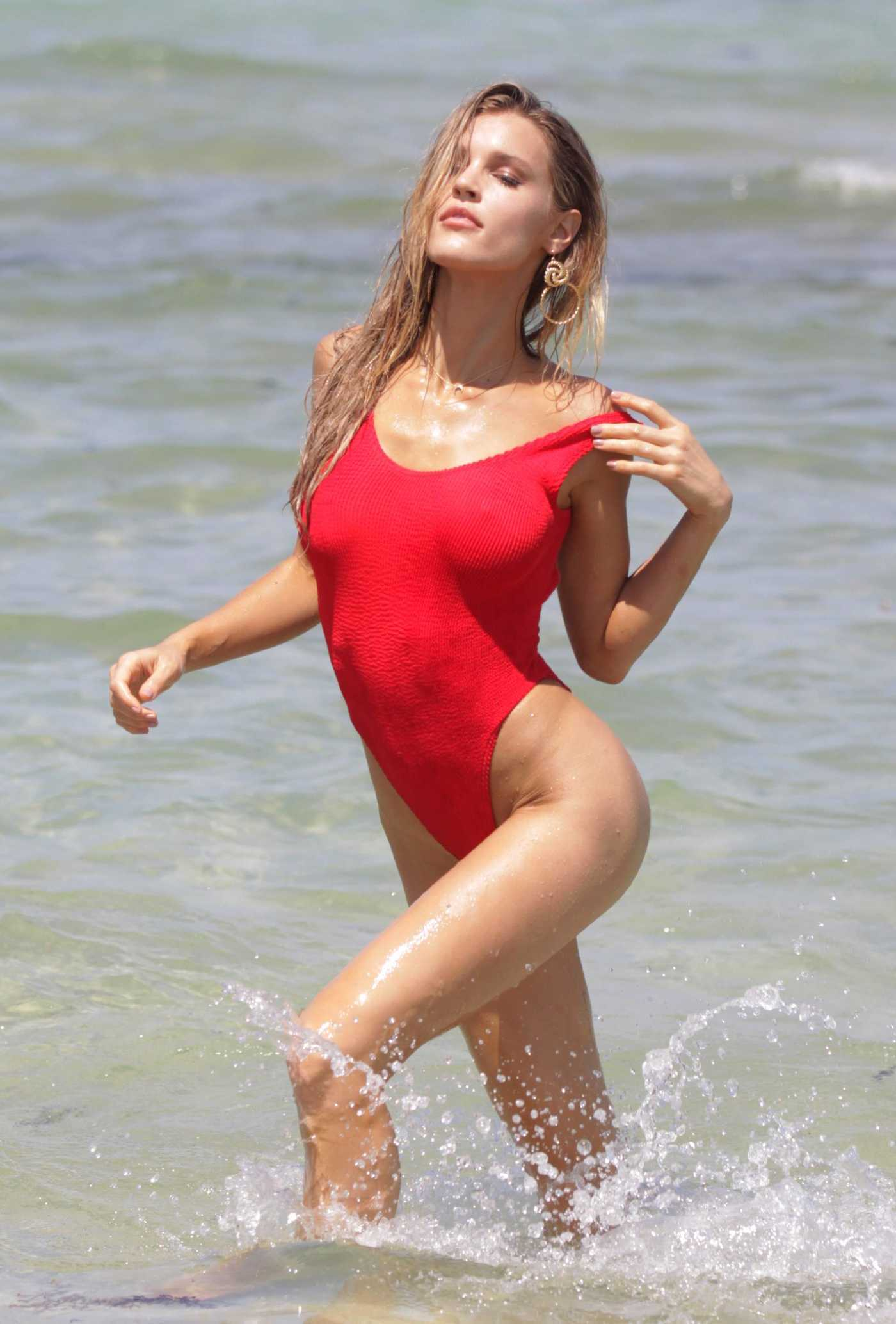 Joy Corrigan Wears a Red Swimsuit During a Photoshoot on the Beach in Miami 07/14/2018