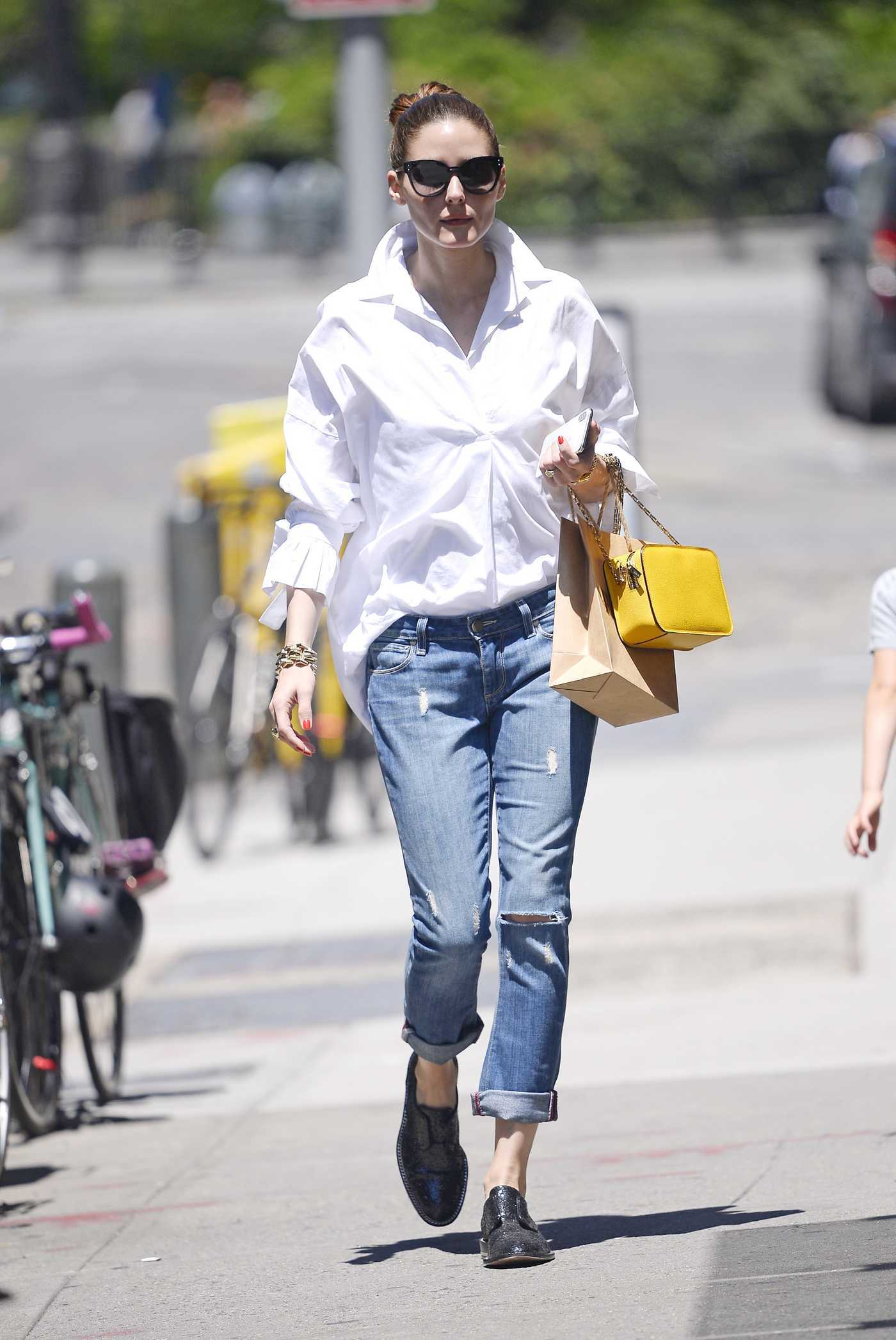 Olivia Palermo Wears a White Long-Sleeved Top and Denim Pants Out in New York 07/10/2018