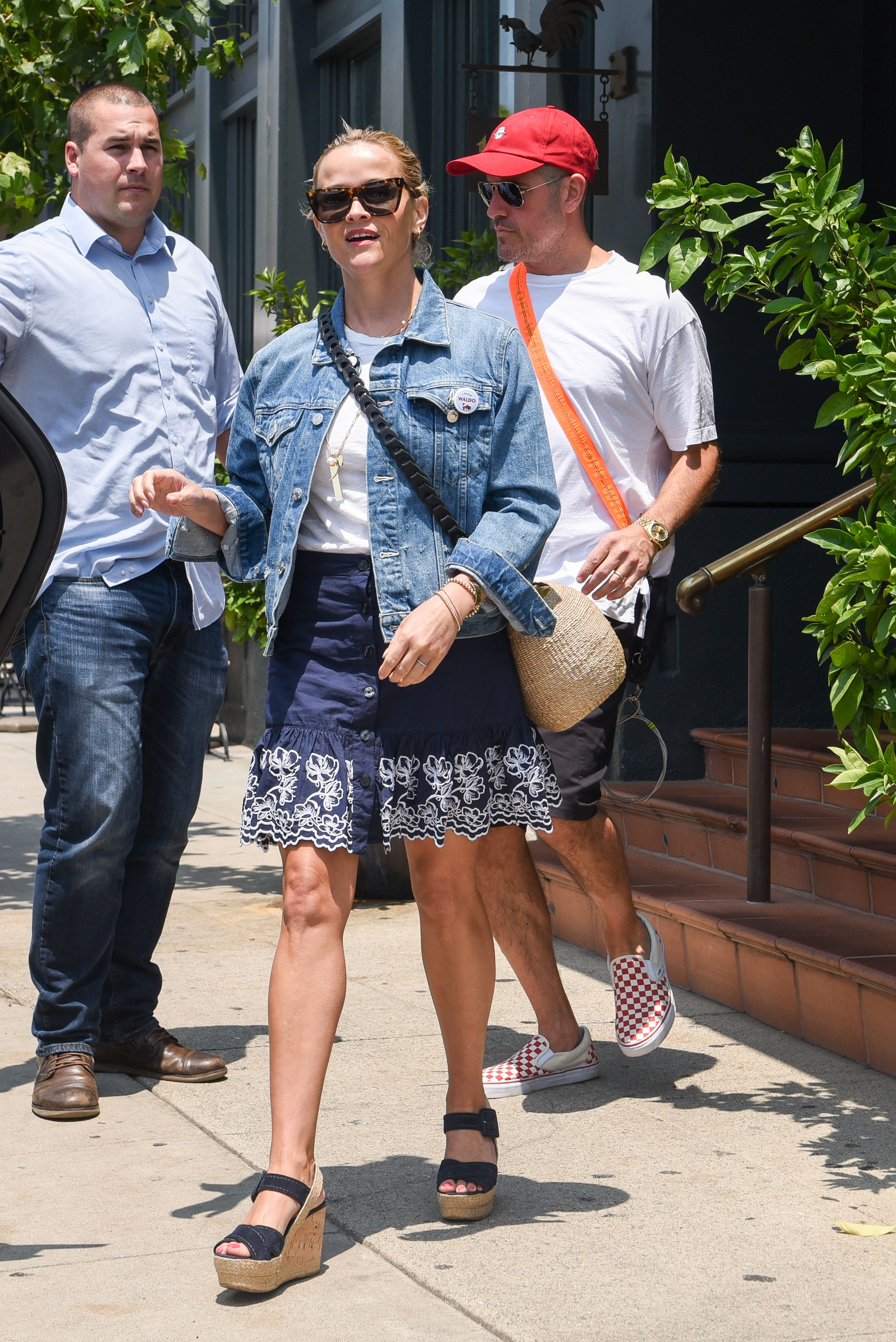Reese Witherspoon in a Blue Denim Jacket Leaves Tavern Restaurant in Brentwood 07/28/2018
