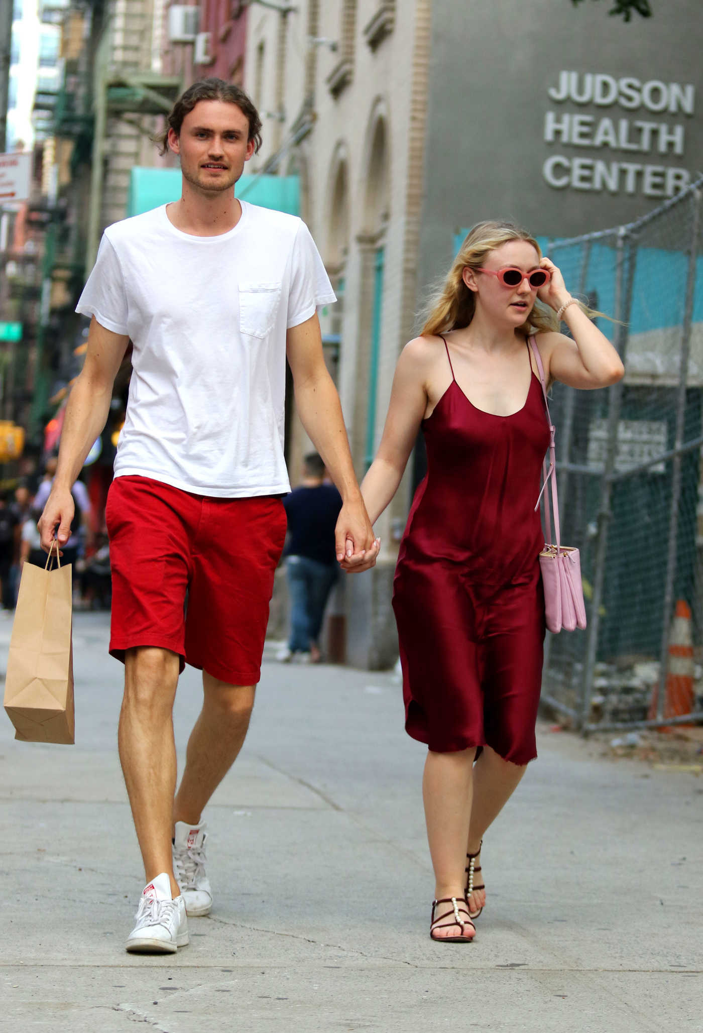 Dakota Fanning in a Burgundy Sundress Was Seen Out with Henry Frye in NYC 08/27/2018