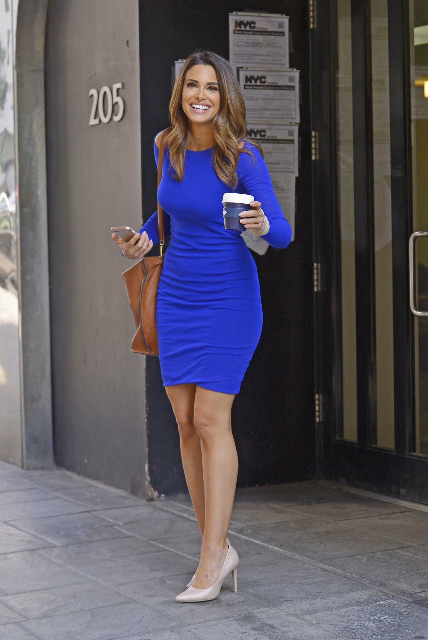 Jennifer Lahmers in a Blue Dress Was Seen Out in New York City 08/24/2018