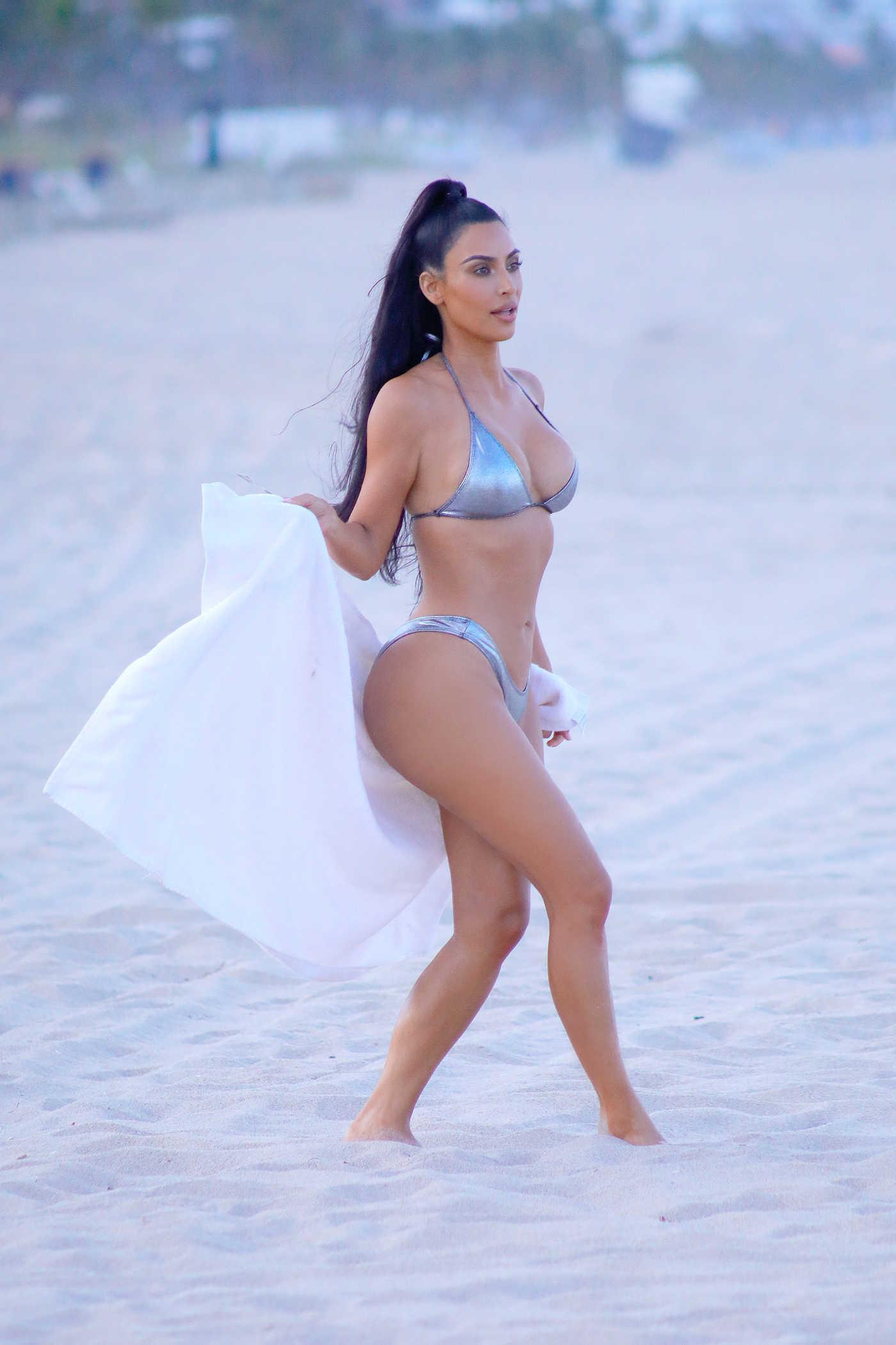 Kim Kardashian in a Silver Bikini During a Photoshoot in Miami 08/18/2018