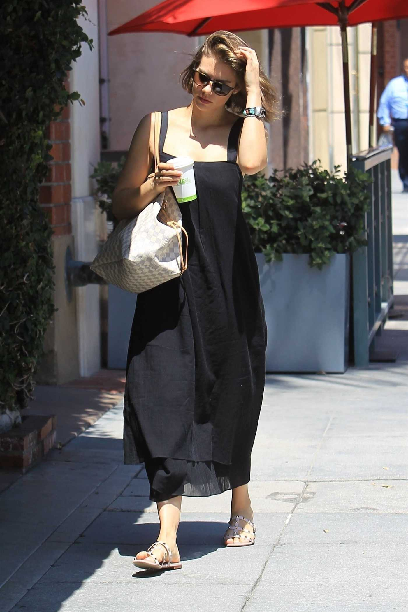 Lauren Cohan in a Black Jumper Dress Leaves a Nail Salon in Beverly Hills 08/01/2018