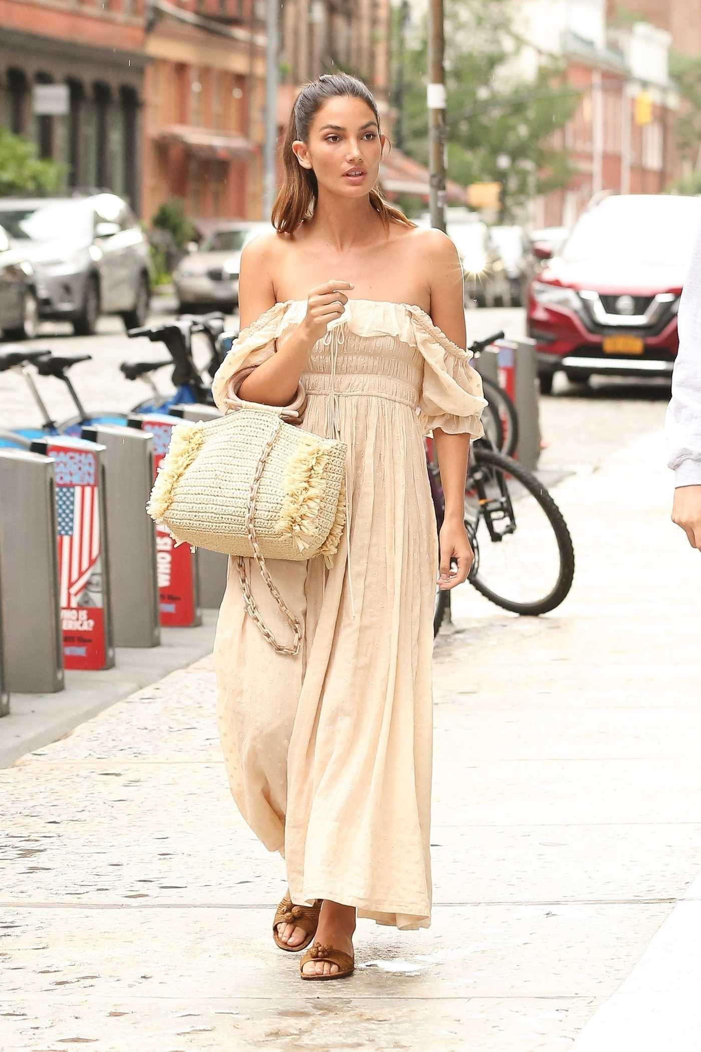 Lily Aldridge in a Beige Long Summer Dress Was Seen Out in New York 08/14/2018