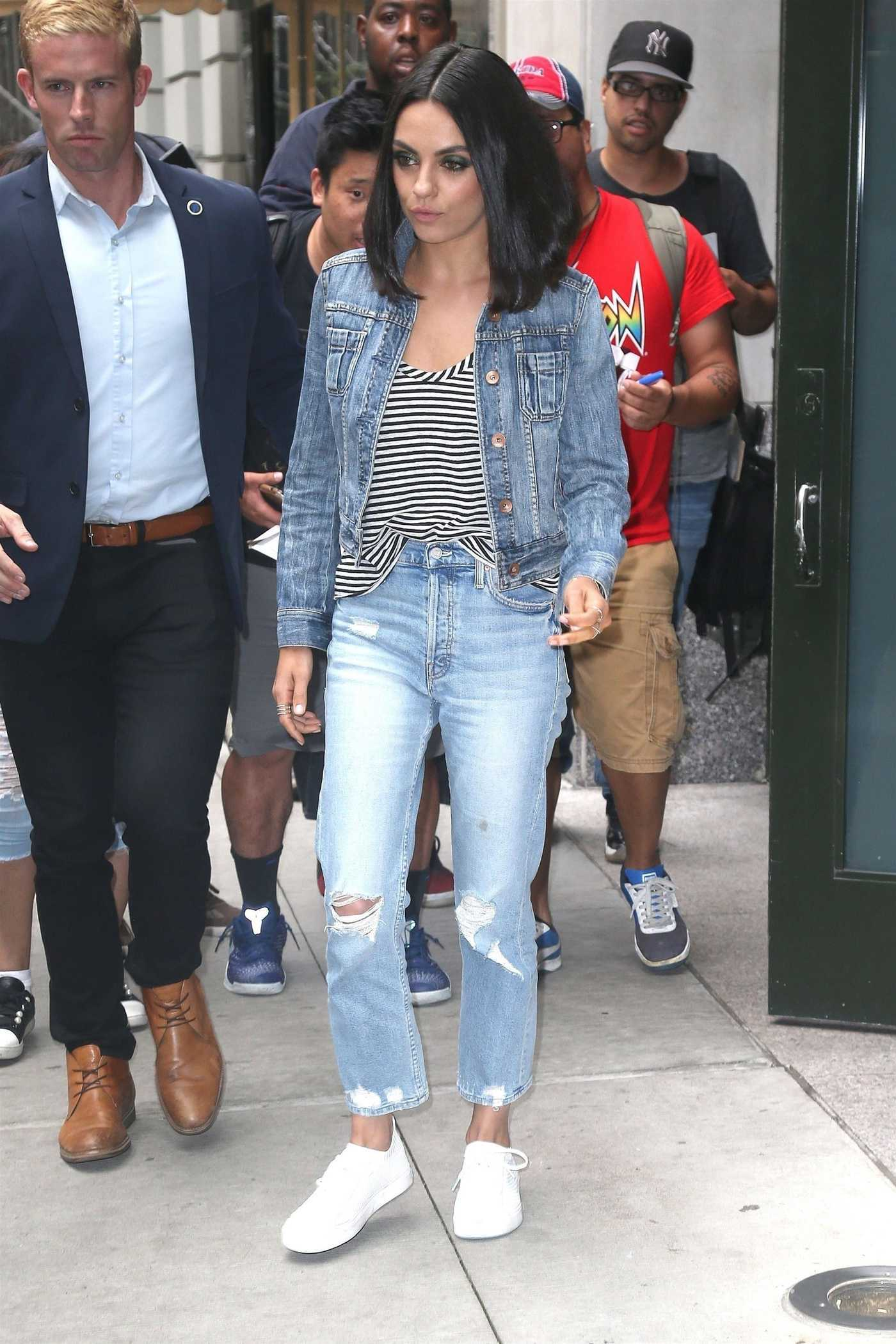 Mila Kunis in a Blue Ripped Jeans Was Seen Out in New York City 07/30/2018