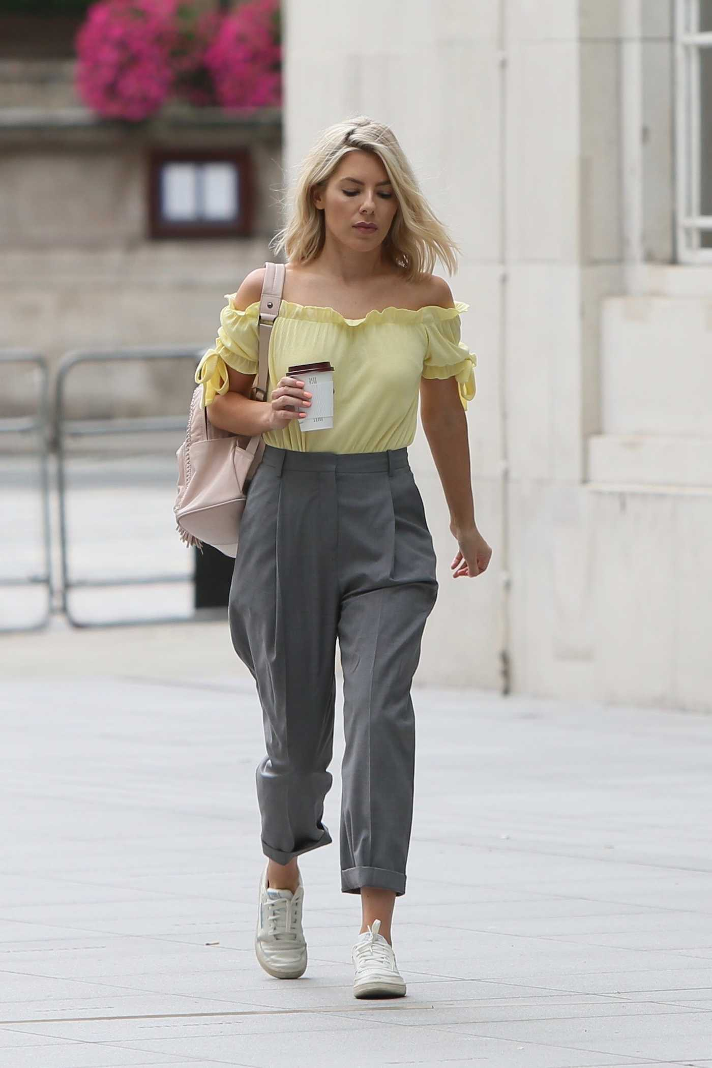Mollie King in a Yellow Strapless Blouse Arrives at the BBC Radio 1 Studios in London 08/14/2018