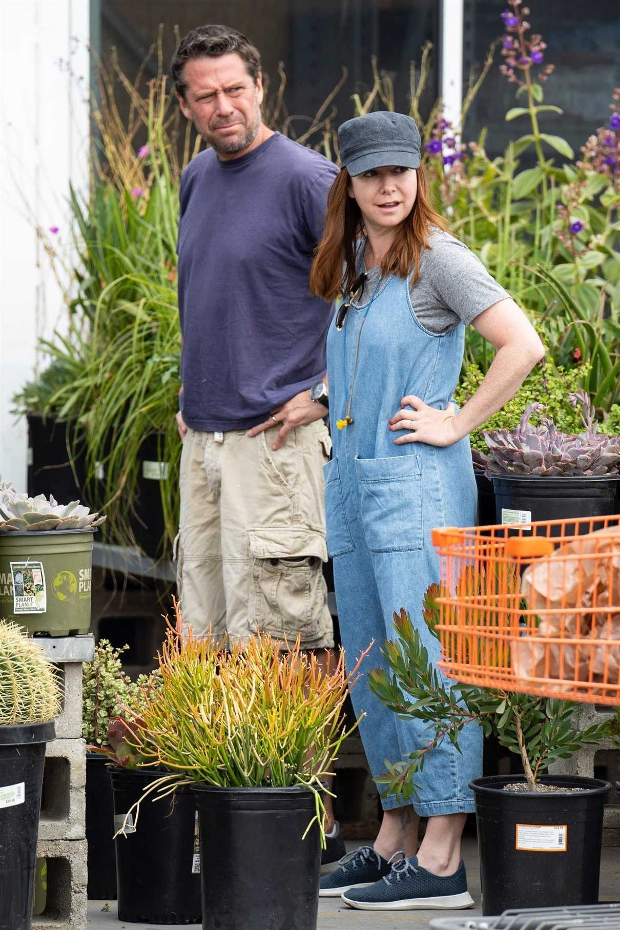 Alyson Hannigan in a Blue Overalls Does Some Flower Shopping at Home Depot in Los Angeles 09/02/2018