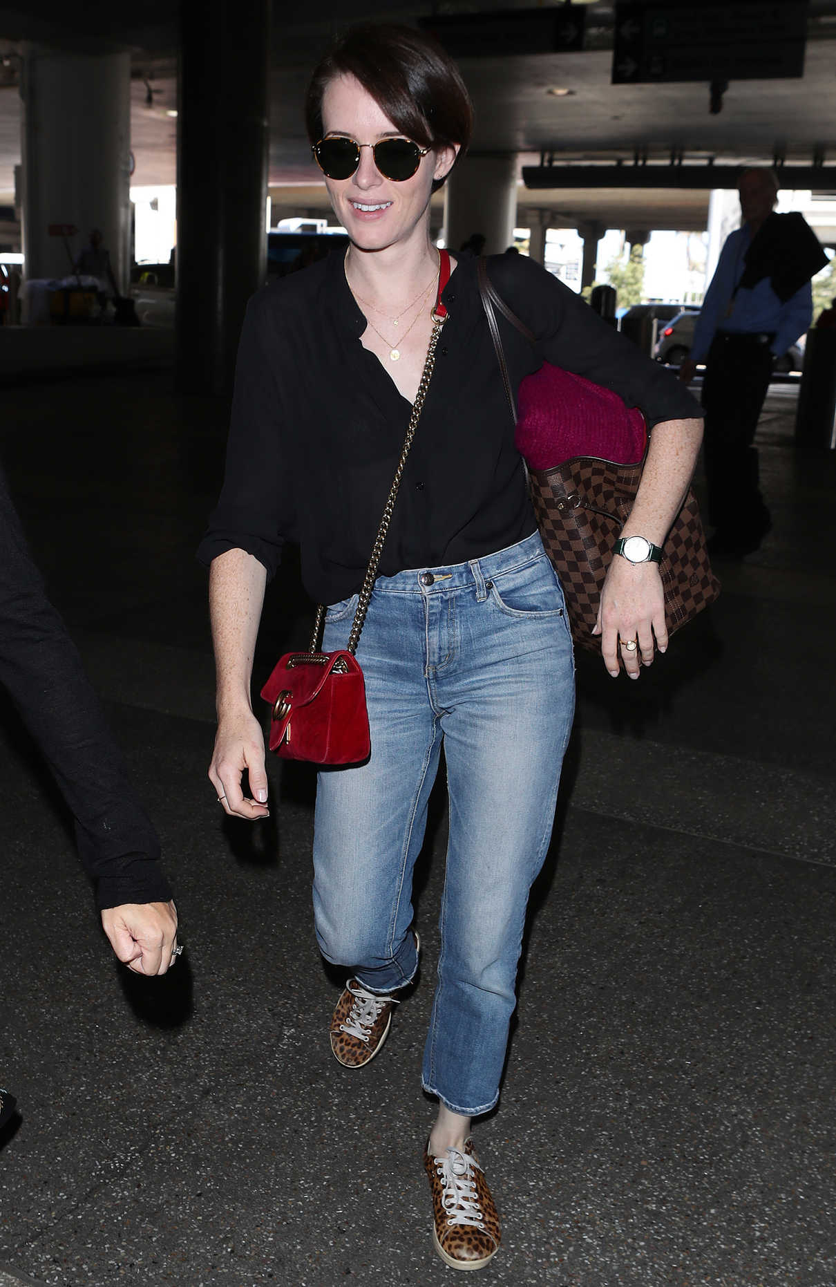 Claire Foy in an Animal Print Sneakers Arrives at LAX Airport in LA 09/19/2018