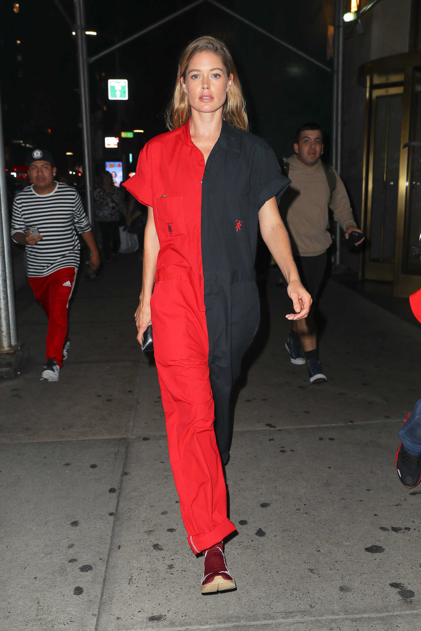 Doutzen Kroes in a Black and Red Overalls Was Seen Out in New York. 09/11/2018