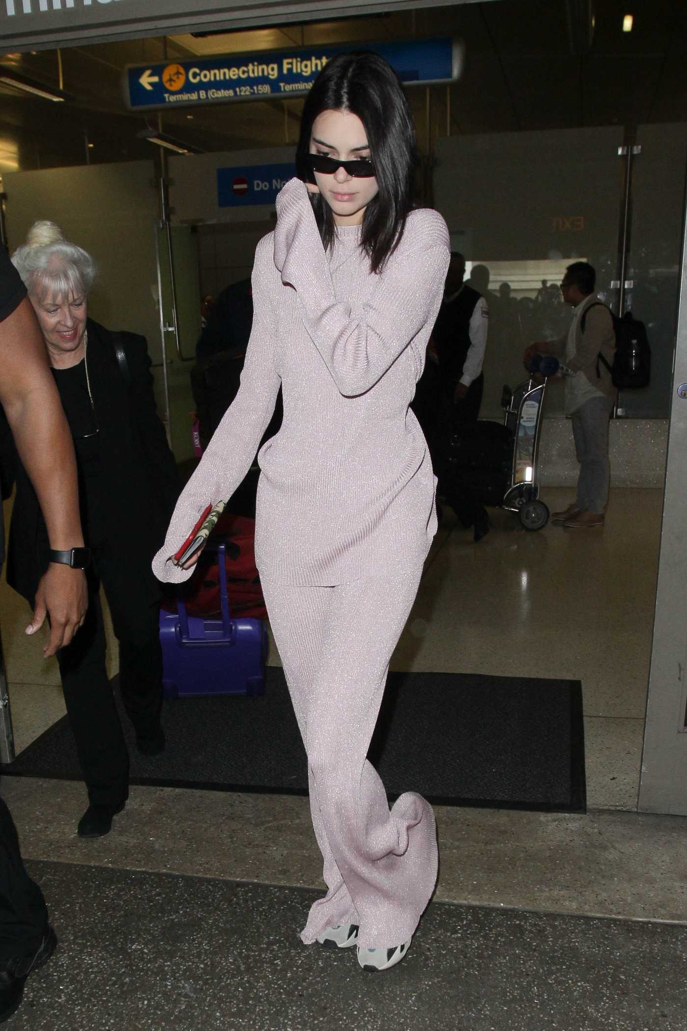 Kendall Jenner in a Purple Suit Arrives at LAX Airport in Los Angeles 09/28/2018