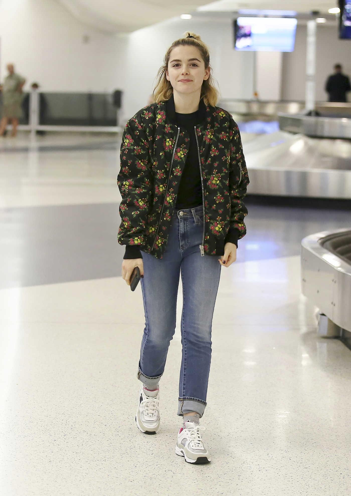 Kiernan Shipka in a Black Floral Print Jacket Arrives at LAX Airport in Los Angeles 09/29/2018