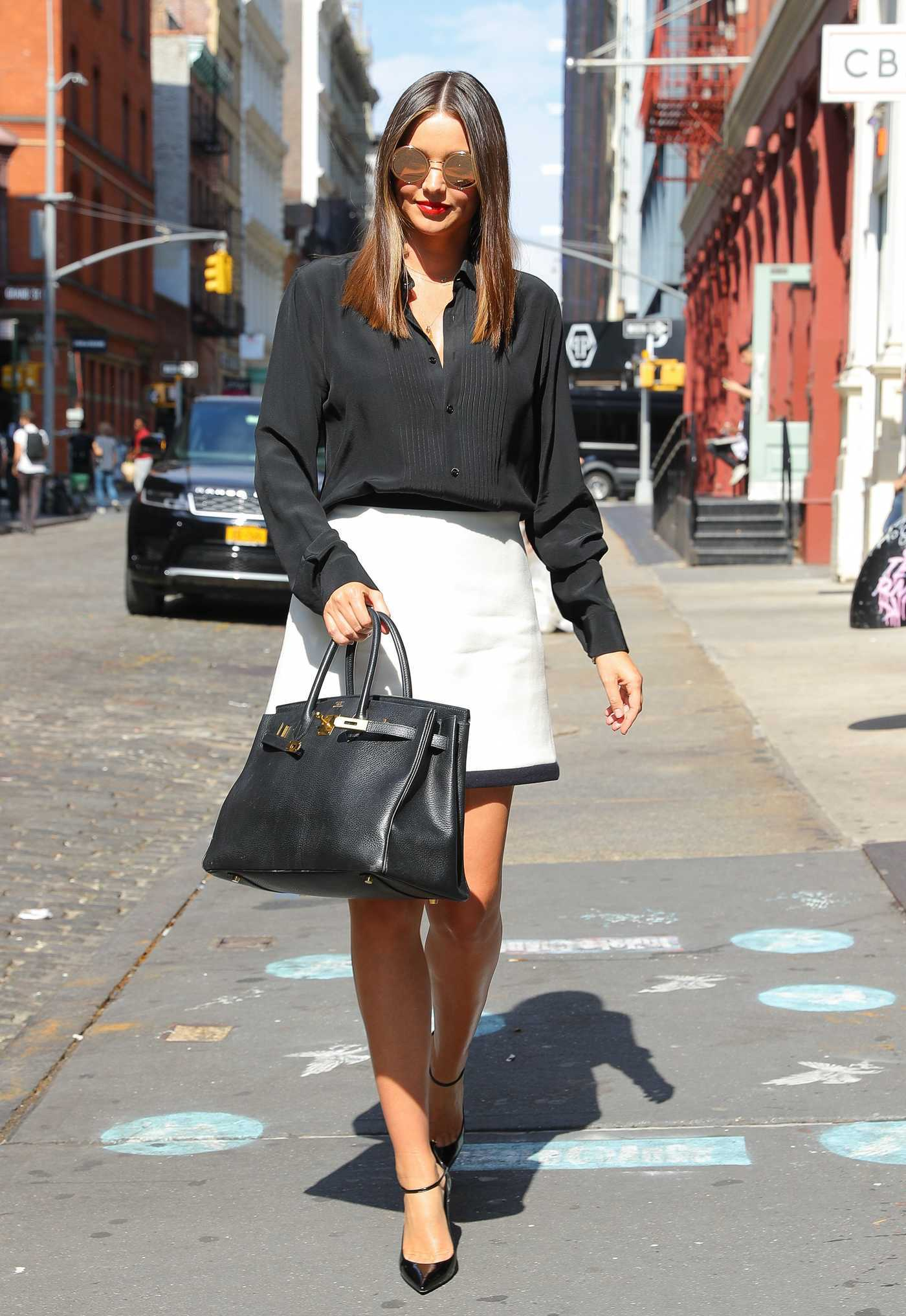 Miranda Kerr in a Short White Skirt Was Seen Out in New York 09/20/2018