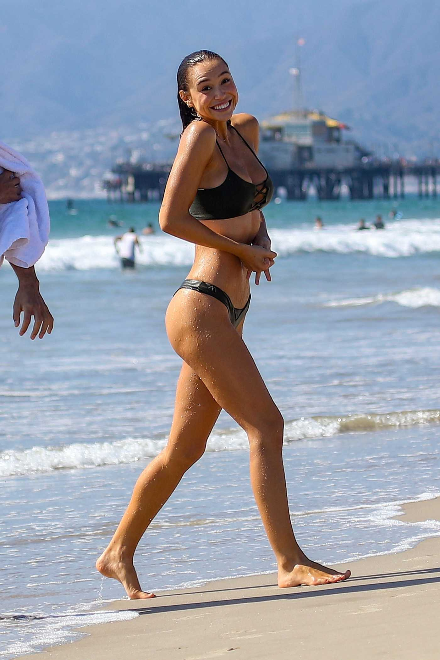 Alexis Ren in a Black Bikini on the Beach in Santa Monica 09/30/2018