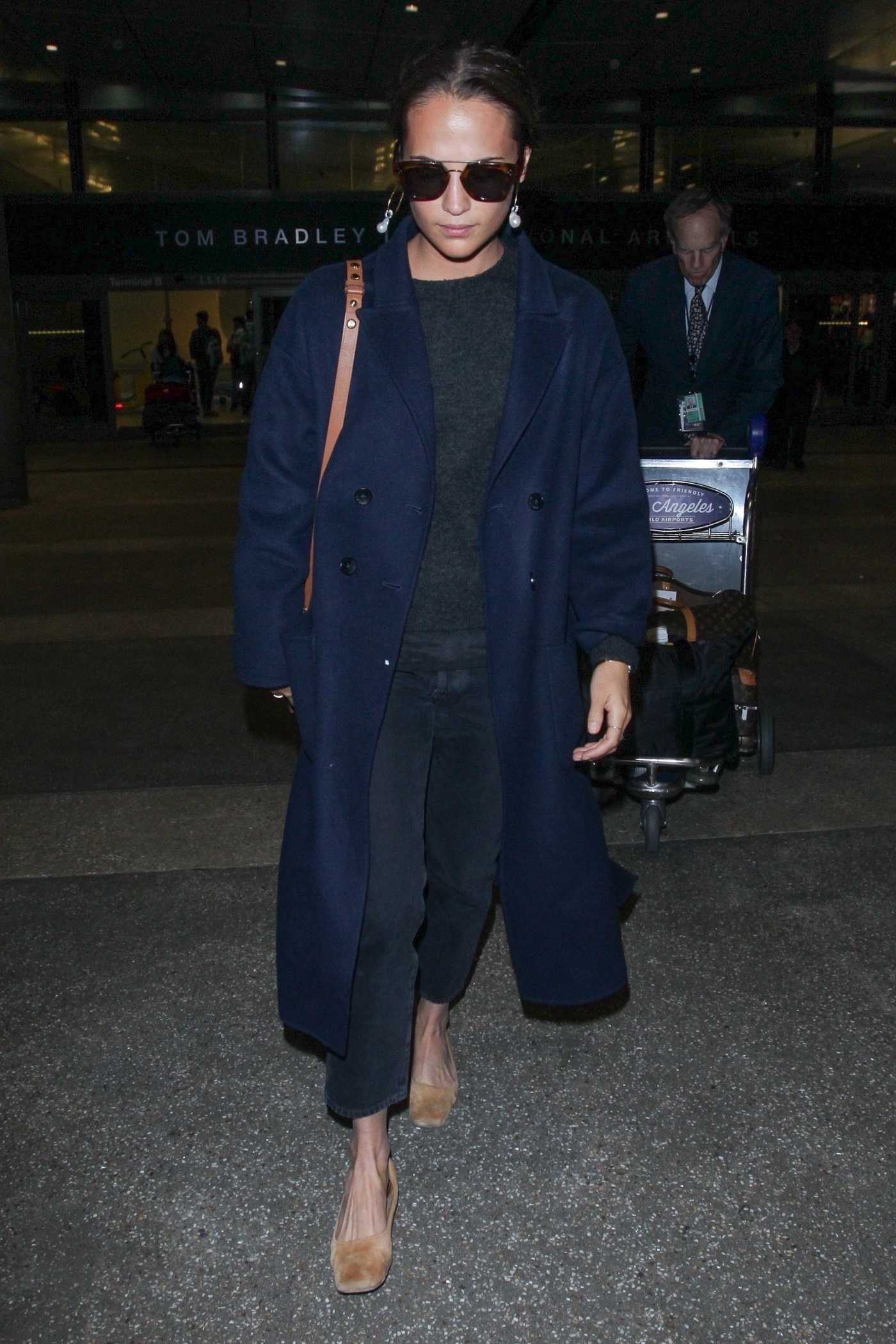 Alicia Vikander in a Dark Blue Coat Arrives at LAX Airport in Los Angeles 10/19/2018