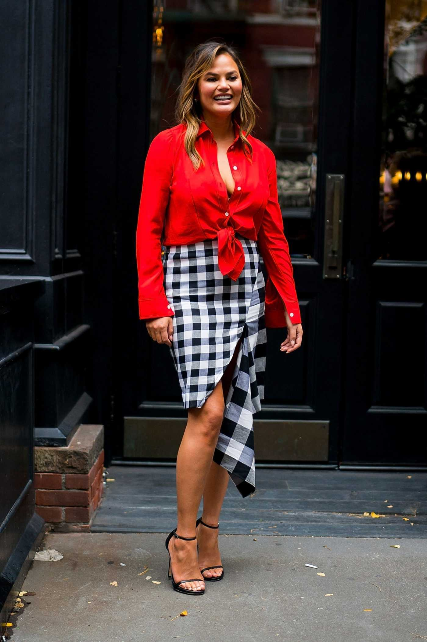 Chrissy Teigen in a Red Shirt Was Seen Out in New York City 10/13/2018