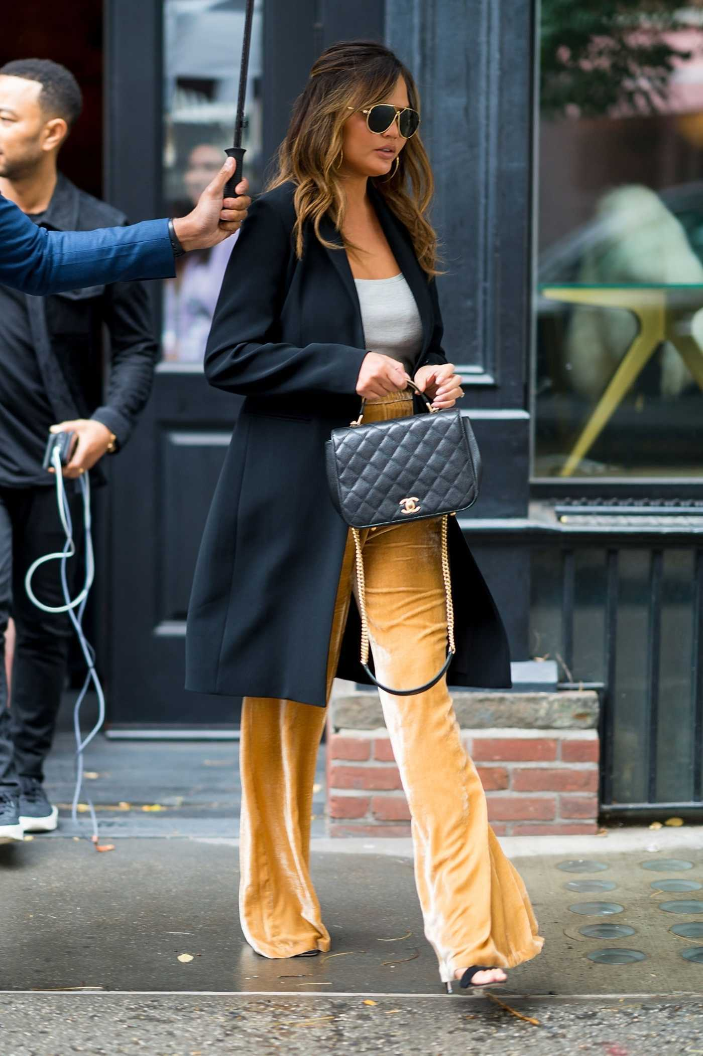 Chrissy Teigen in a Yellow Pants Was Seen in Little Italy in New York City 10/12/2018