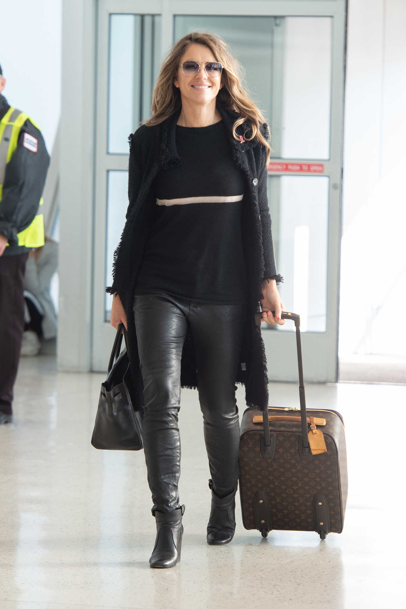 Elizabeth Hurley in a Black Leather Pants Arrives at JFK Airport in NYC 10/12/2018