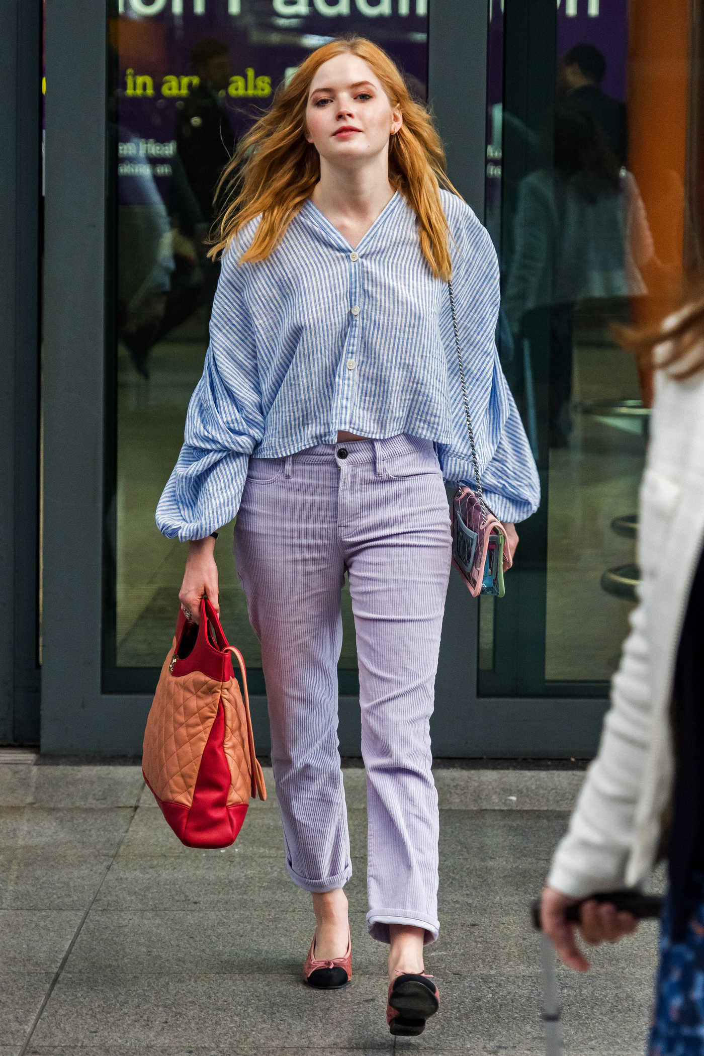 Ellie Bamber in a Striped Blouse Arrives at Heathrow Airport in London 10/17/2018