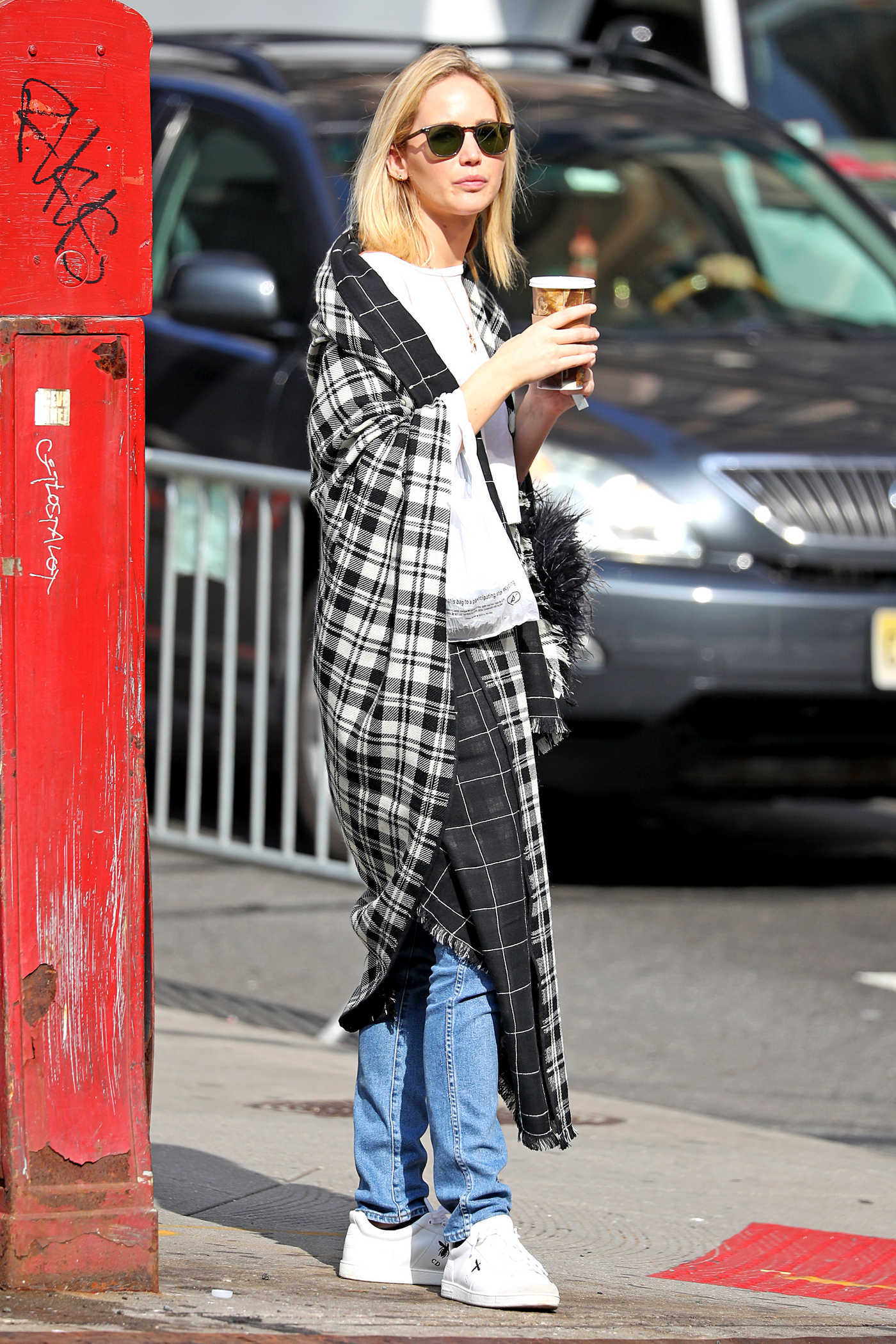 Jennifer Lawrence in a Plaid Cape-Scarf Was Seen Out in NYC 10/05/2018