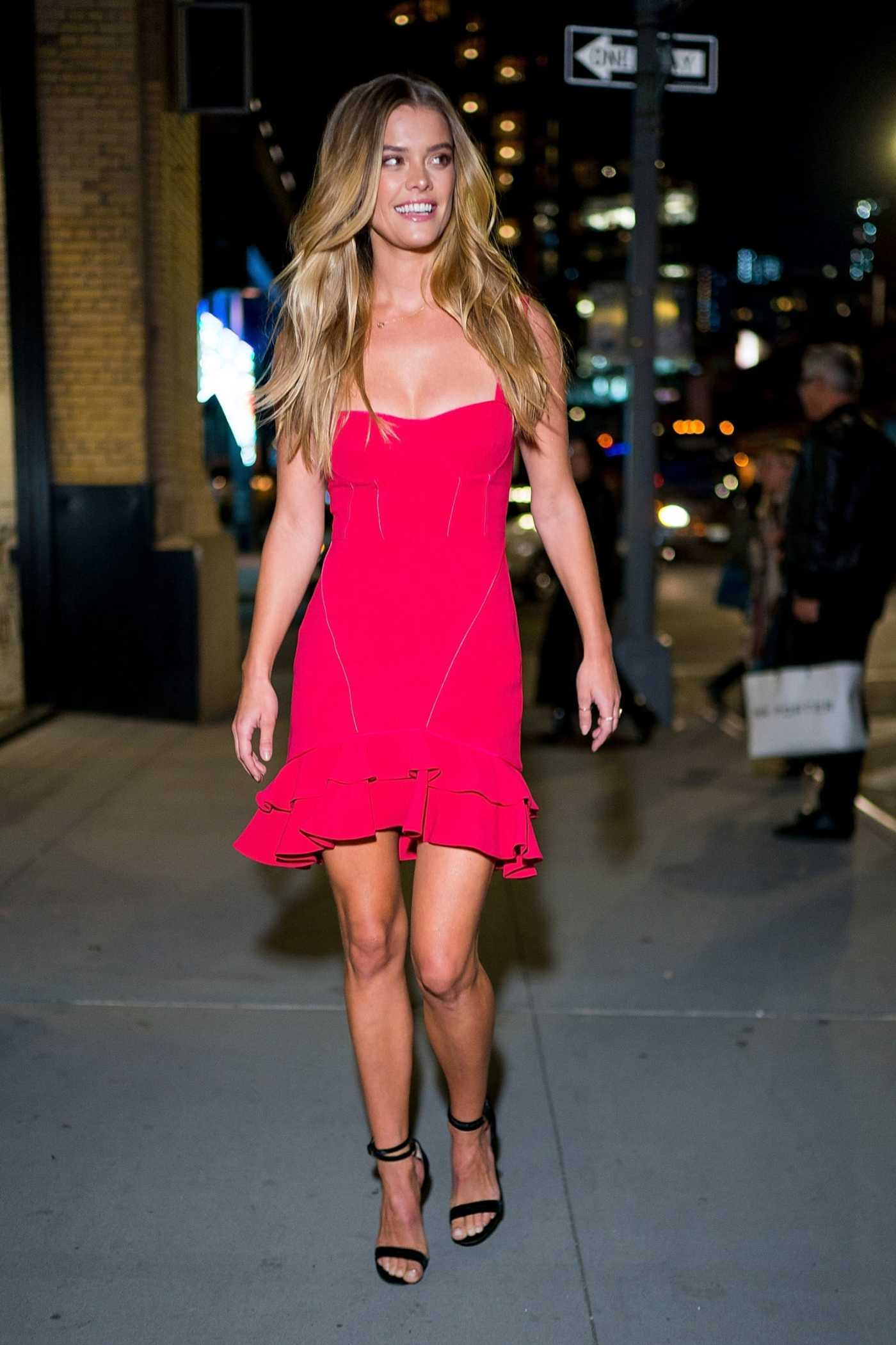Nina Agdal in a Red Dress Arrives at Intermix 25th Anniversary Party in New York City 10/18/2018