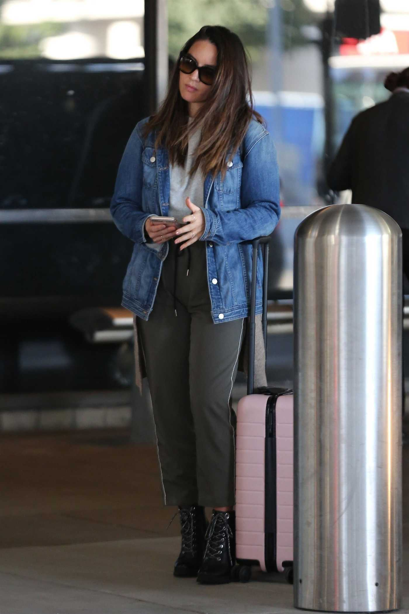 Olivia Munn in a Blue Denim Jacket Arrives at LAX Airport in Los Angeles 10/09/2018