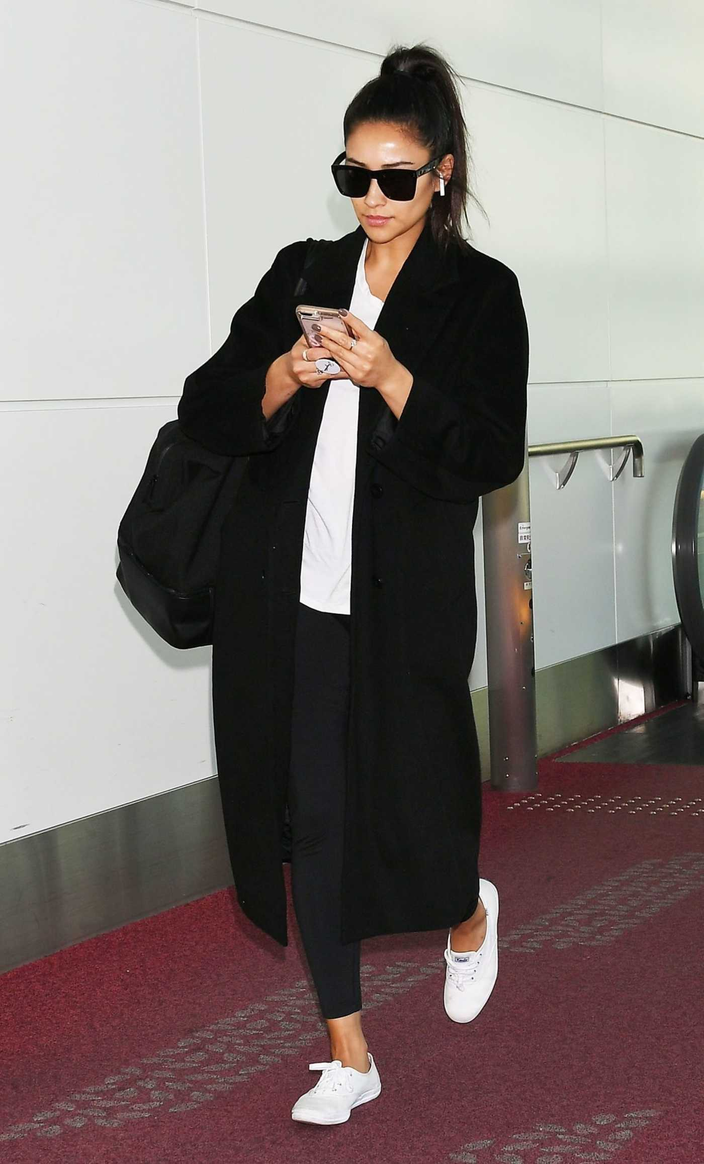 Shay Mitchell in a Black Coat Arrives at Haneda Airport in Tokyo 10/29/2018
