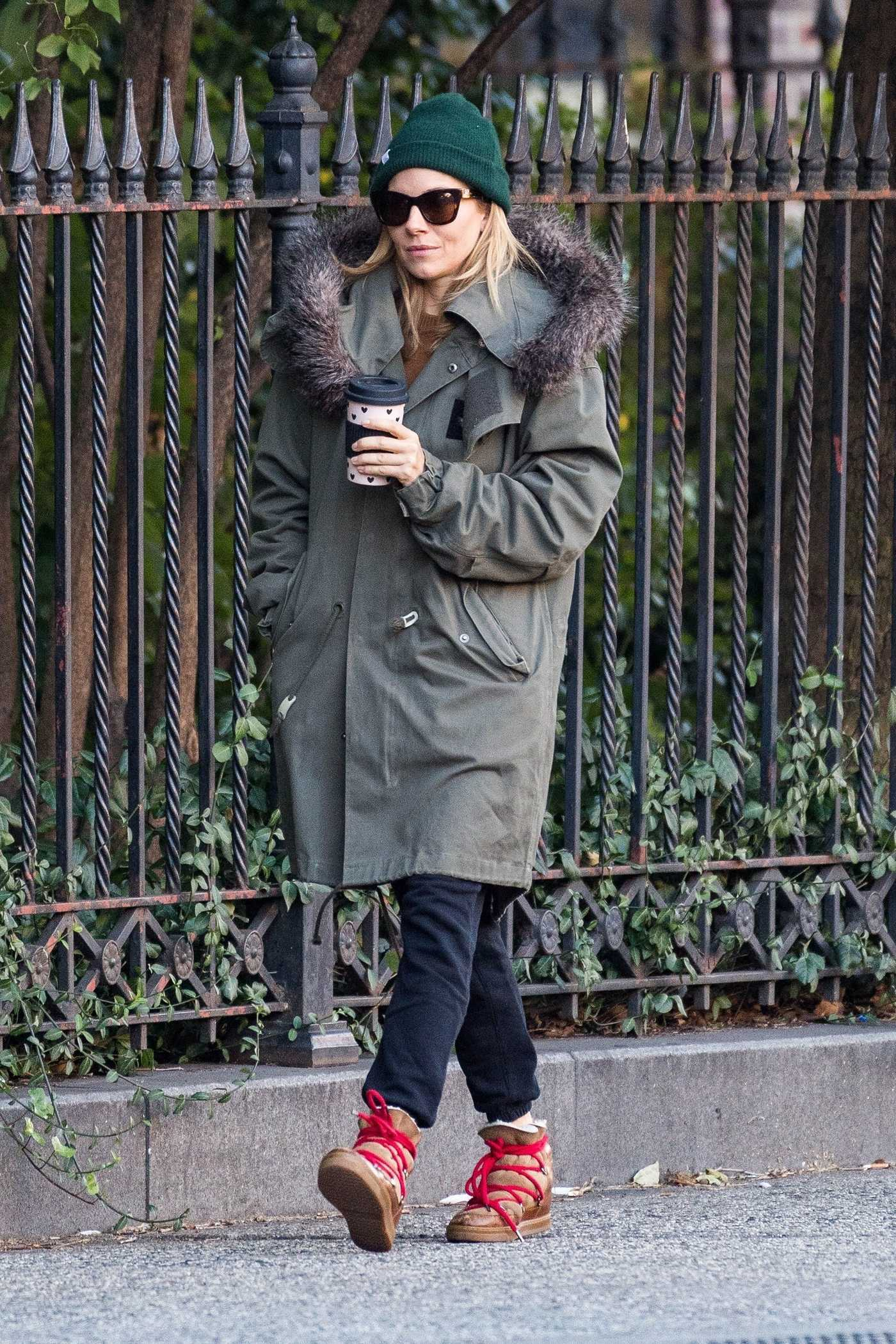 Sienna Miller in a Green Parka Was Seen Out in NYC 10/25/2018