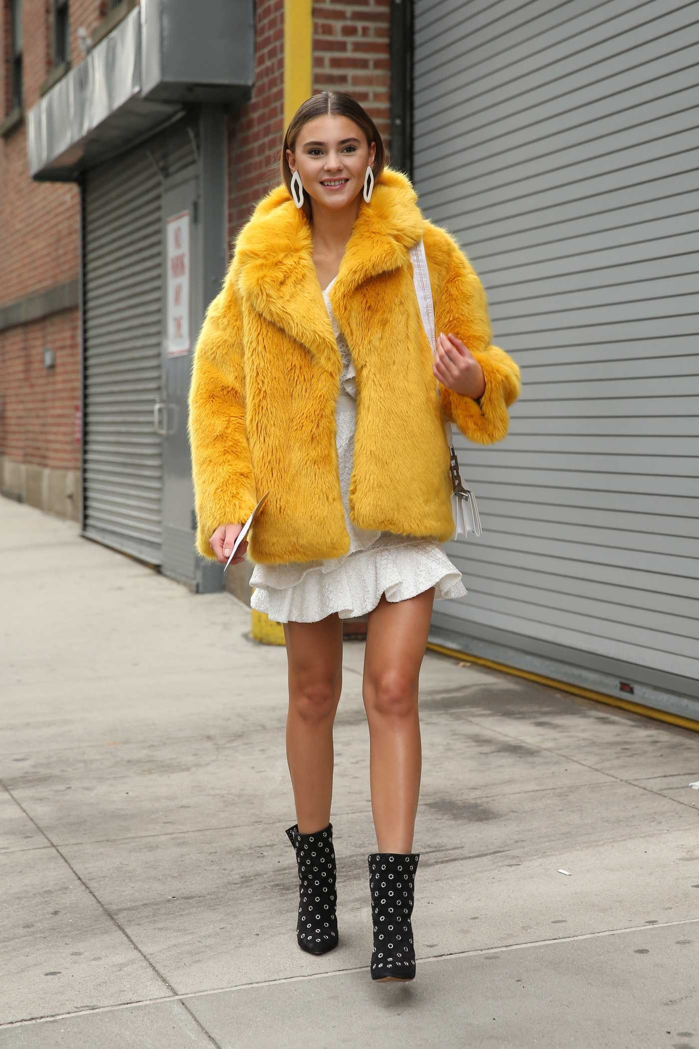 Stefanie Giesinger in a Short Yellow Fur Coat Was Seen Out in New York City 10/02/2018