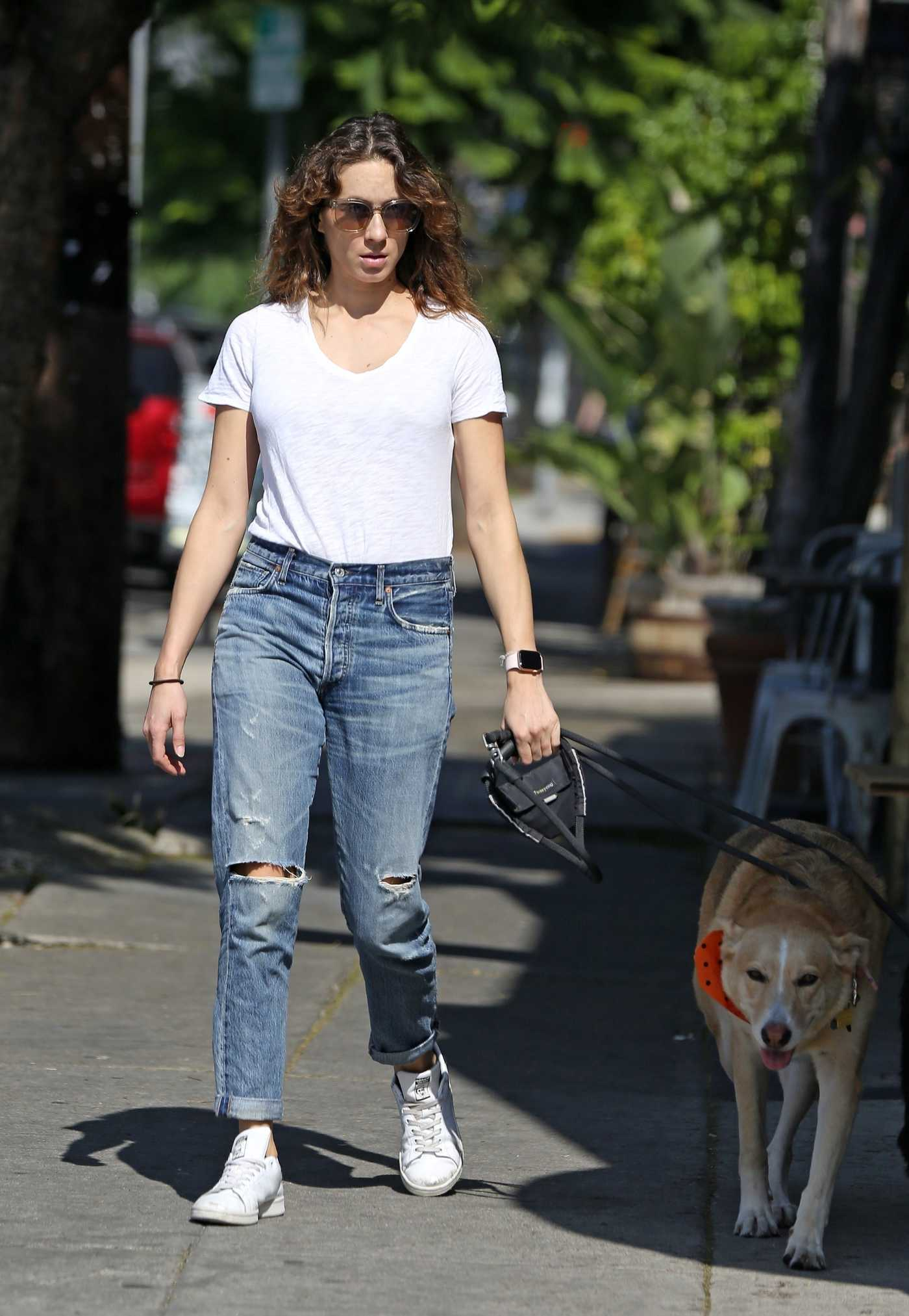 Troian Bellisario in a White T-Shirt Walks with Her Dog in Los Angeles 10/25/2018