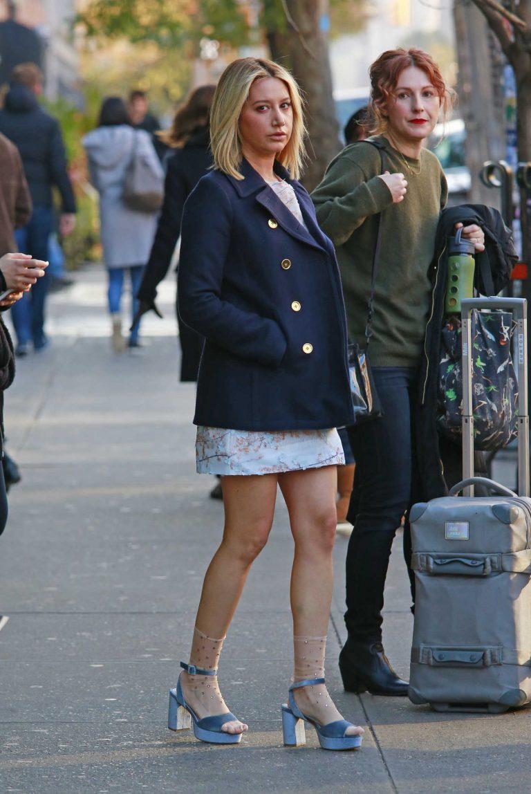 Ashley Tisdale in a Short Dark Blue Coat