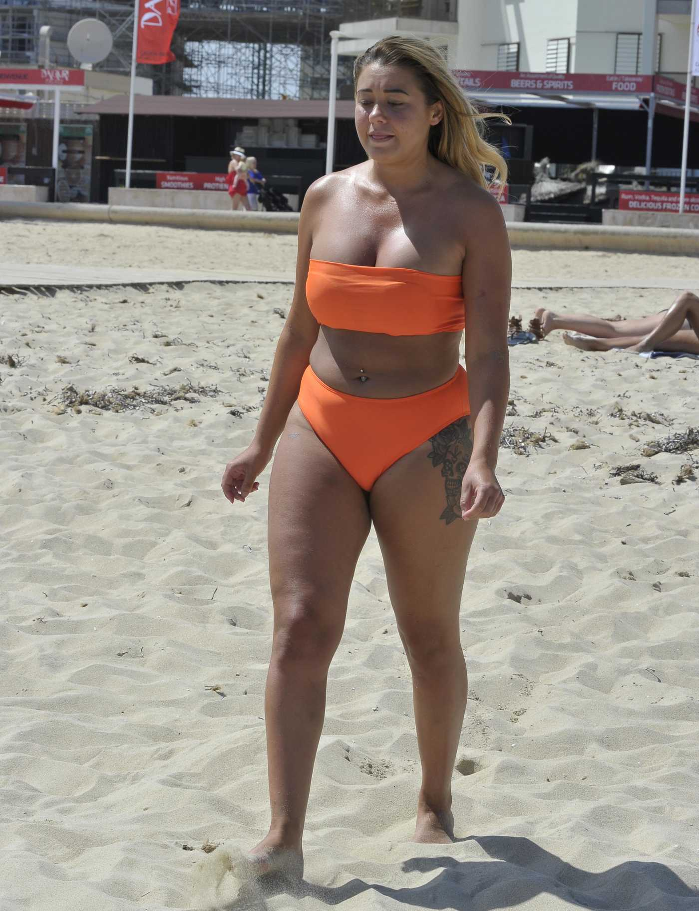 Ellie Young in a Bright Orange Bikini on the Beach in Magaluf 11/08/2018